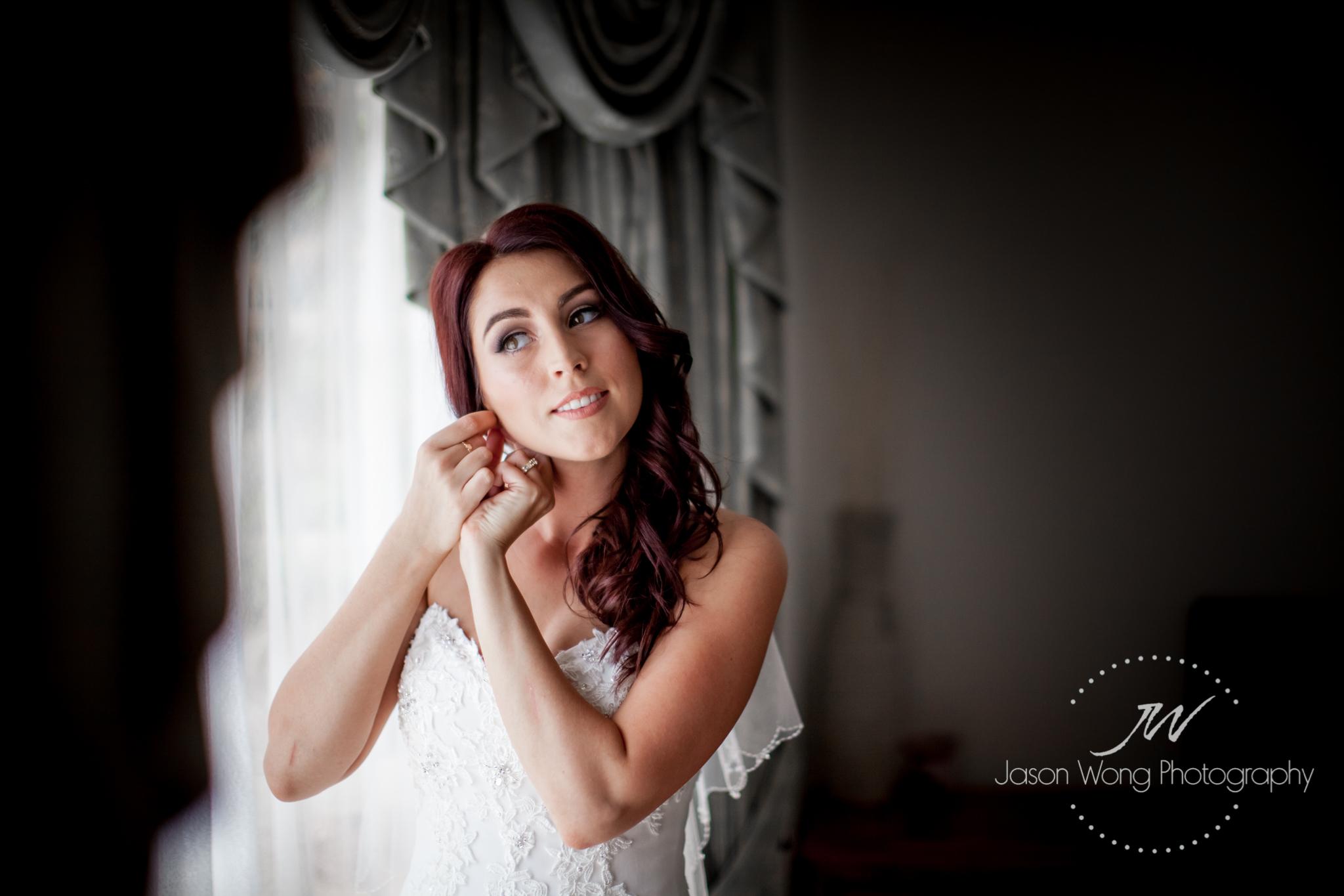 beautiful-bride-putting-on-ear-ring.jpg