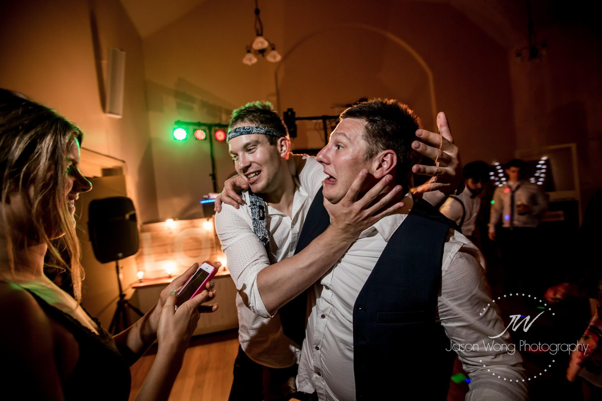 boys-having-fun-during-wedding-reception.jpg
