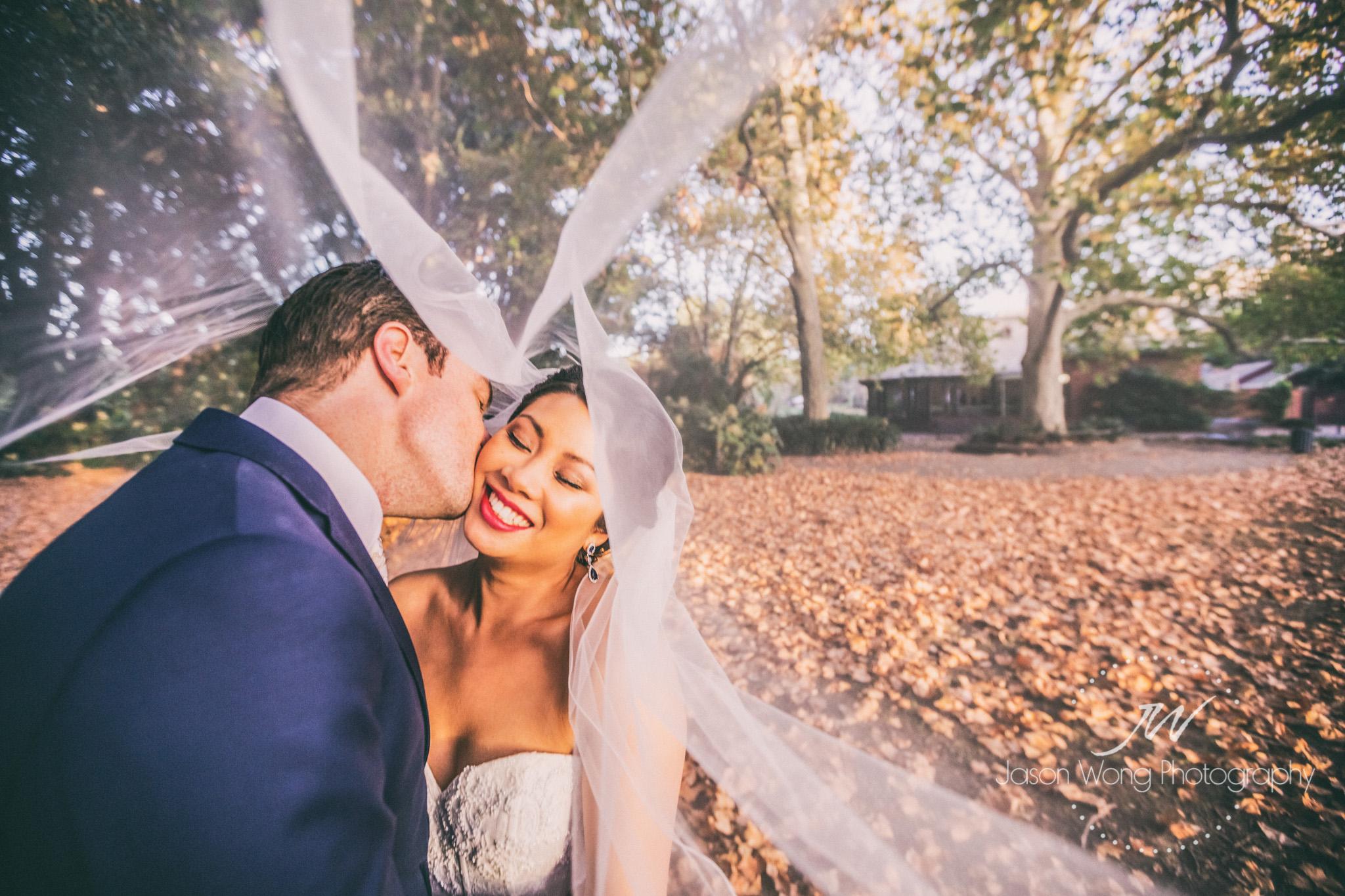 bride-groom-kiss-on-cheek.jpg