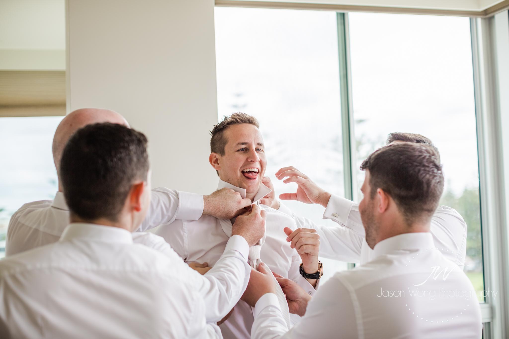 groom-and-groomsmen-having-fun-at-getting-ready.jpg