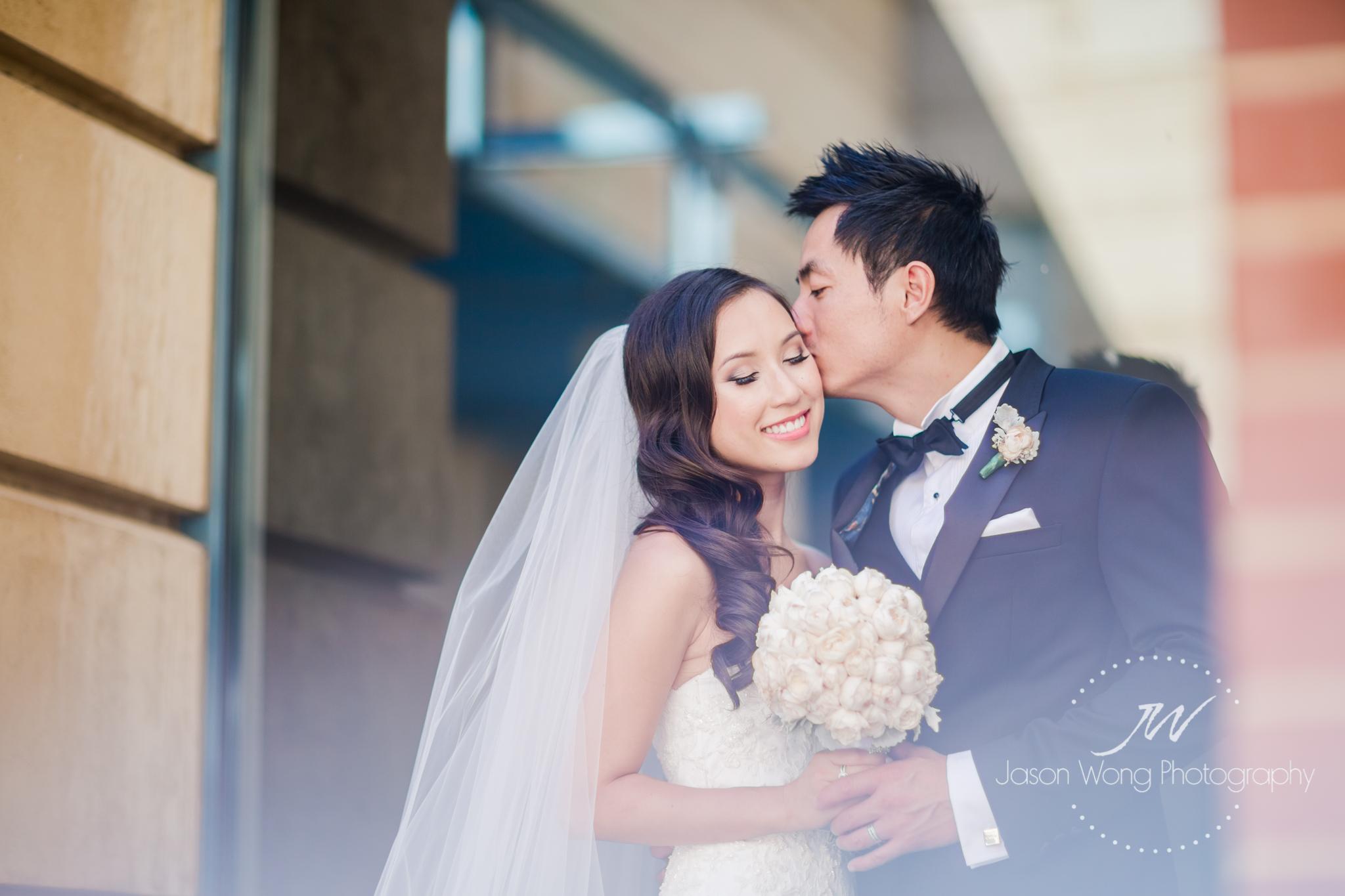 groom-give-sweet-kiss-on-bride-cheek.jpg