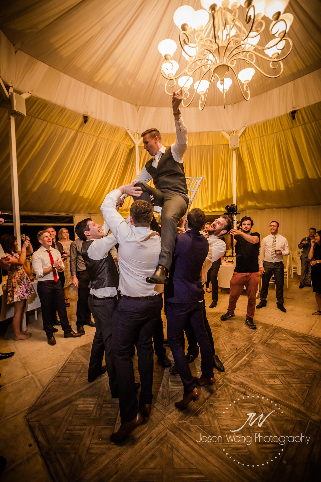 groom-having-fun-getting-toss.jpg