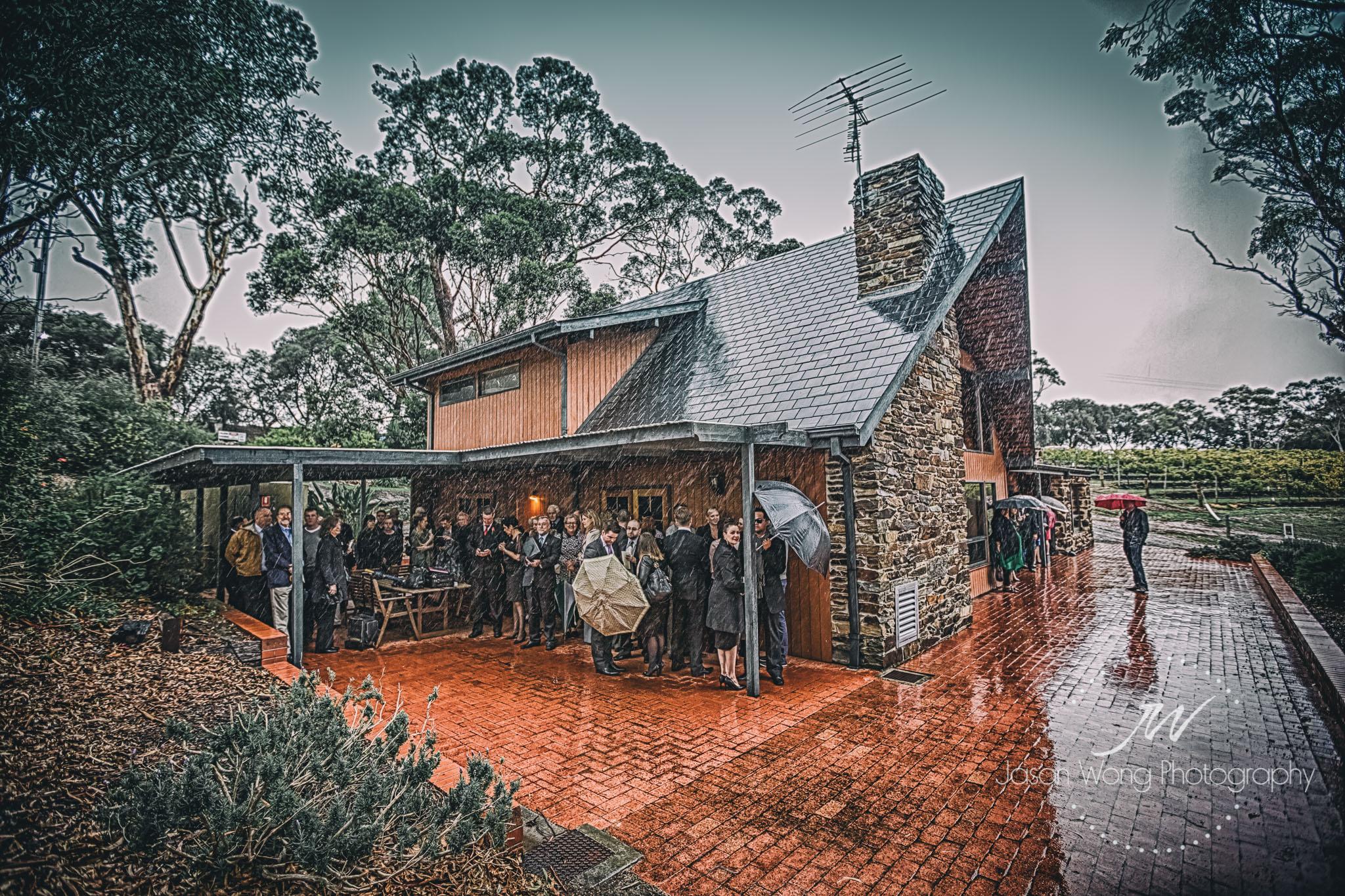 guests-avoiding-rain-at-chapel-hill-wedding-ceremony.jpg