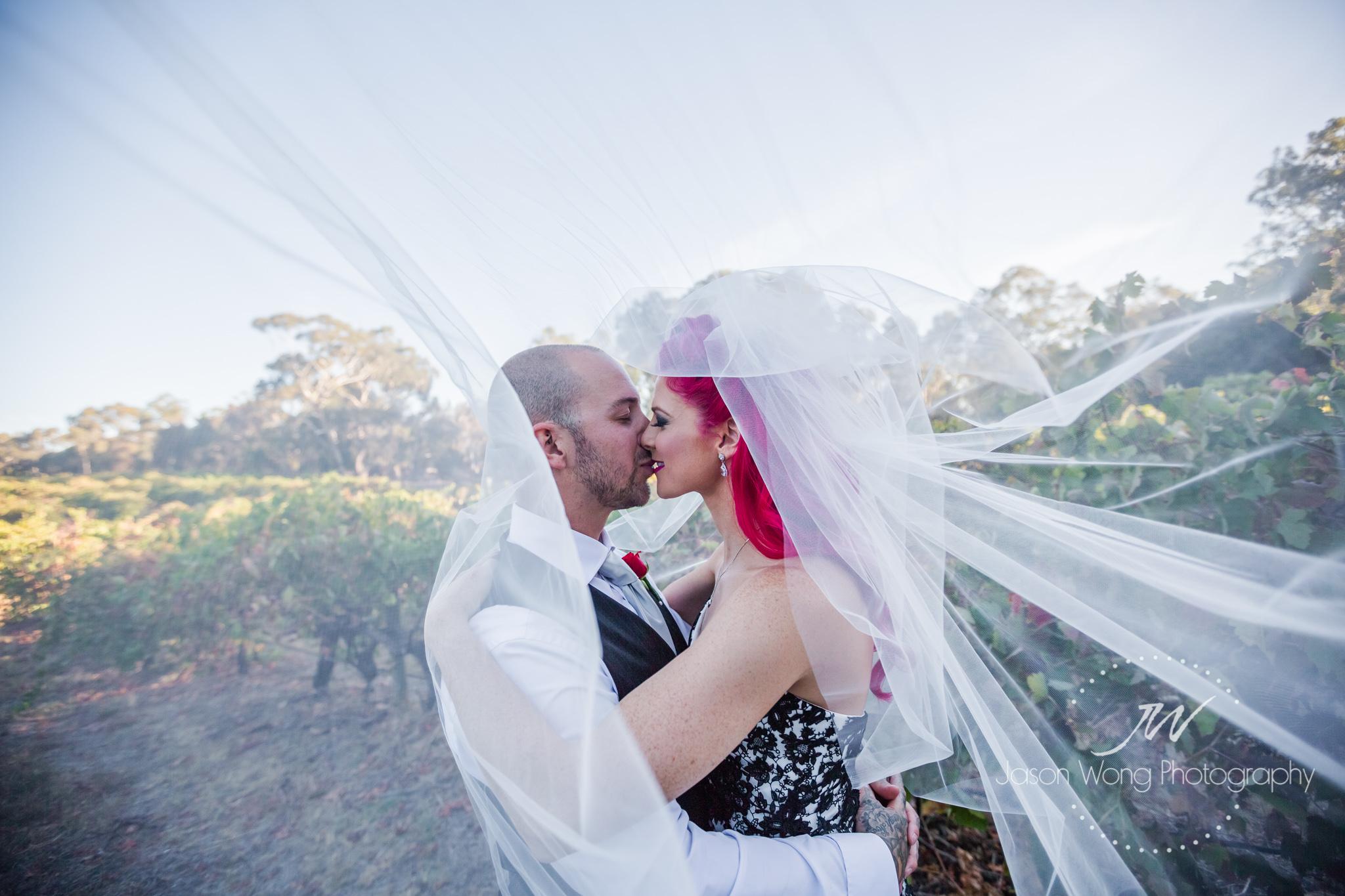 kiss-inside-veil-jason-wong-photography-style.jpg