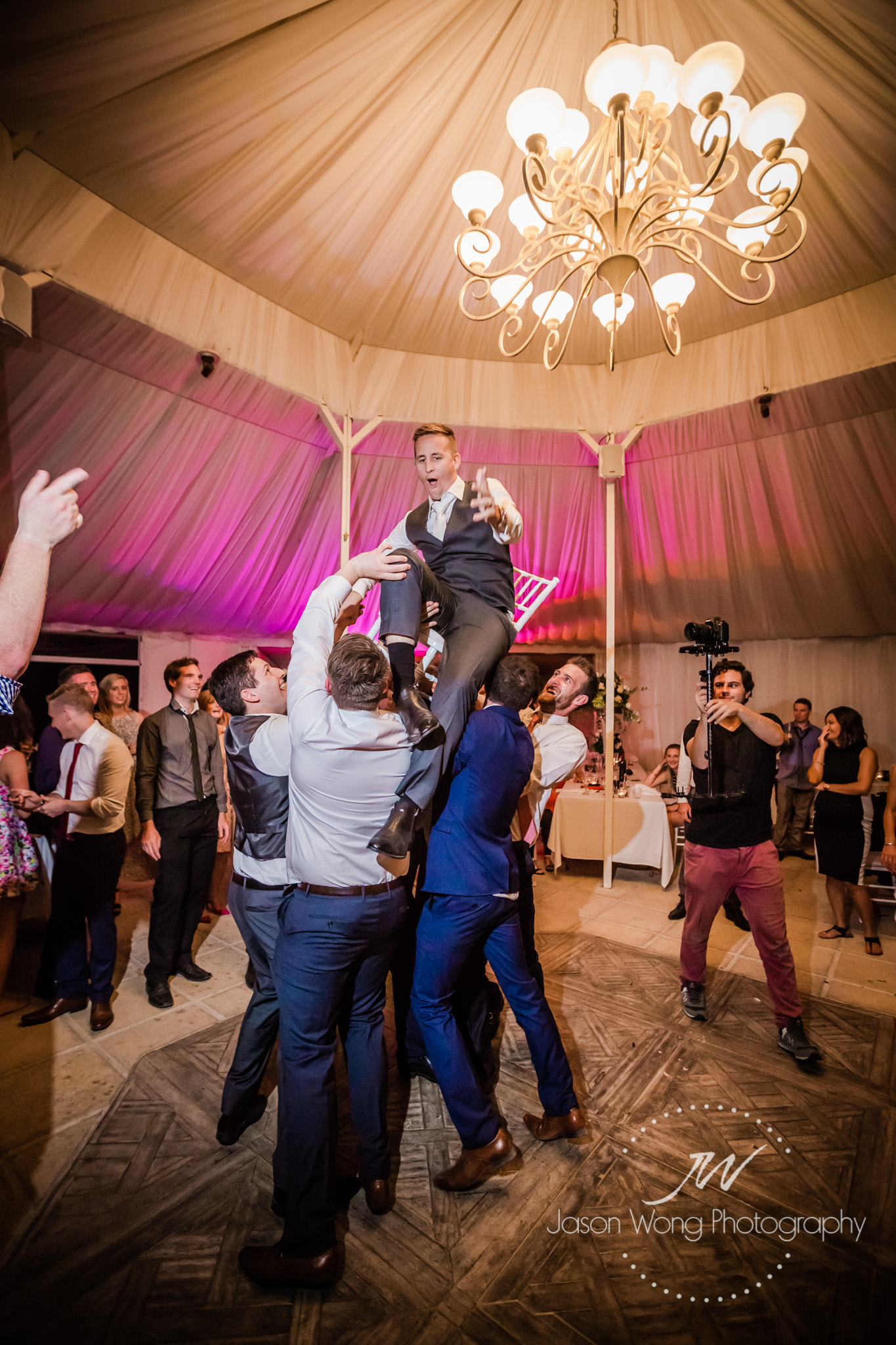 reception-fun-groom-getting-carry.jpg