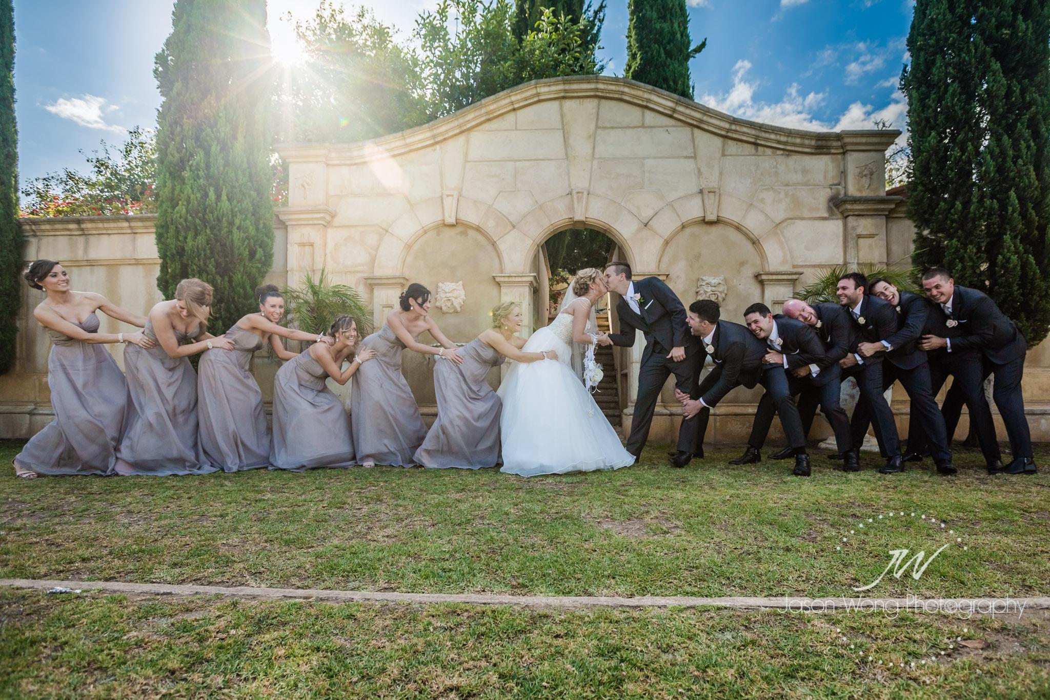 tug-o-wall-for-bride-and-groom-jason-wong-photography-style.jpg