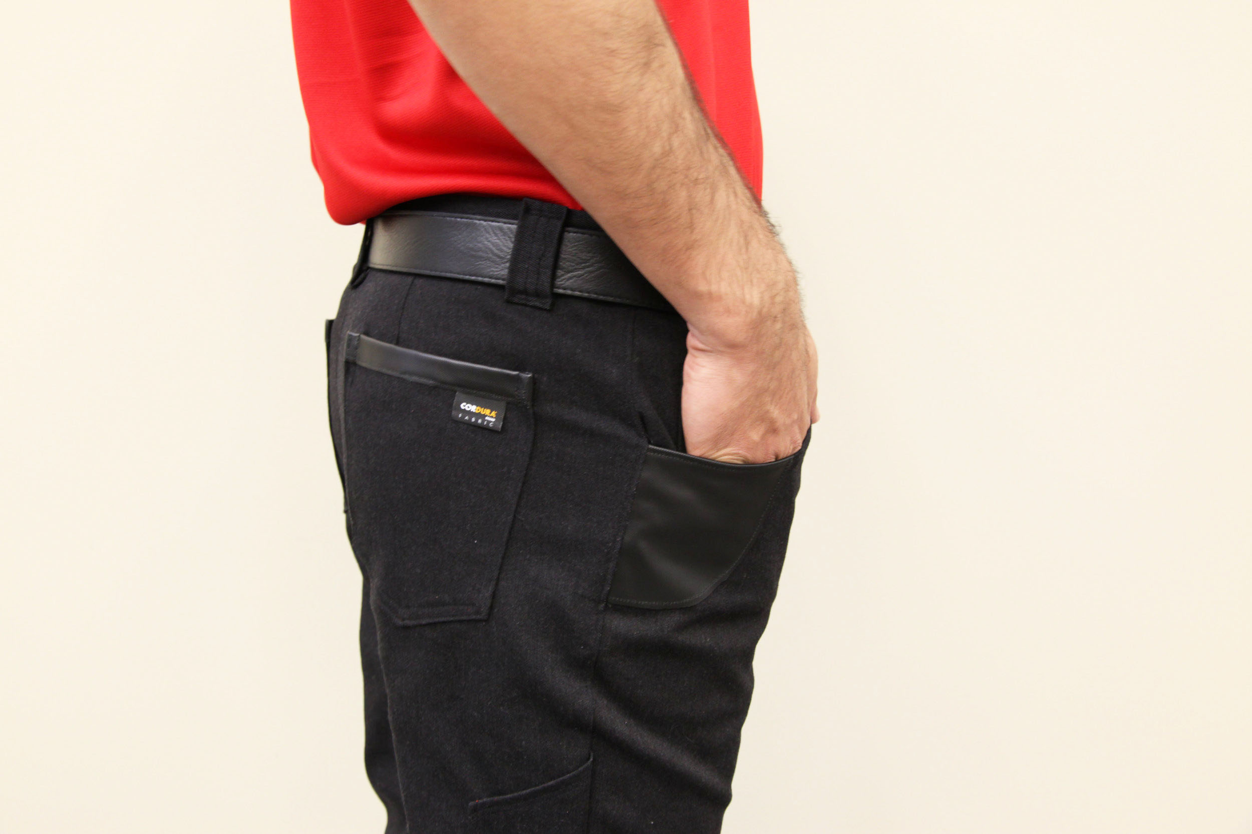 Ballistic Trim at Front and Back Pocket with Wide Belt Loops and Branding