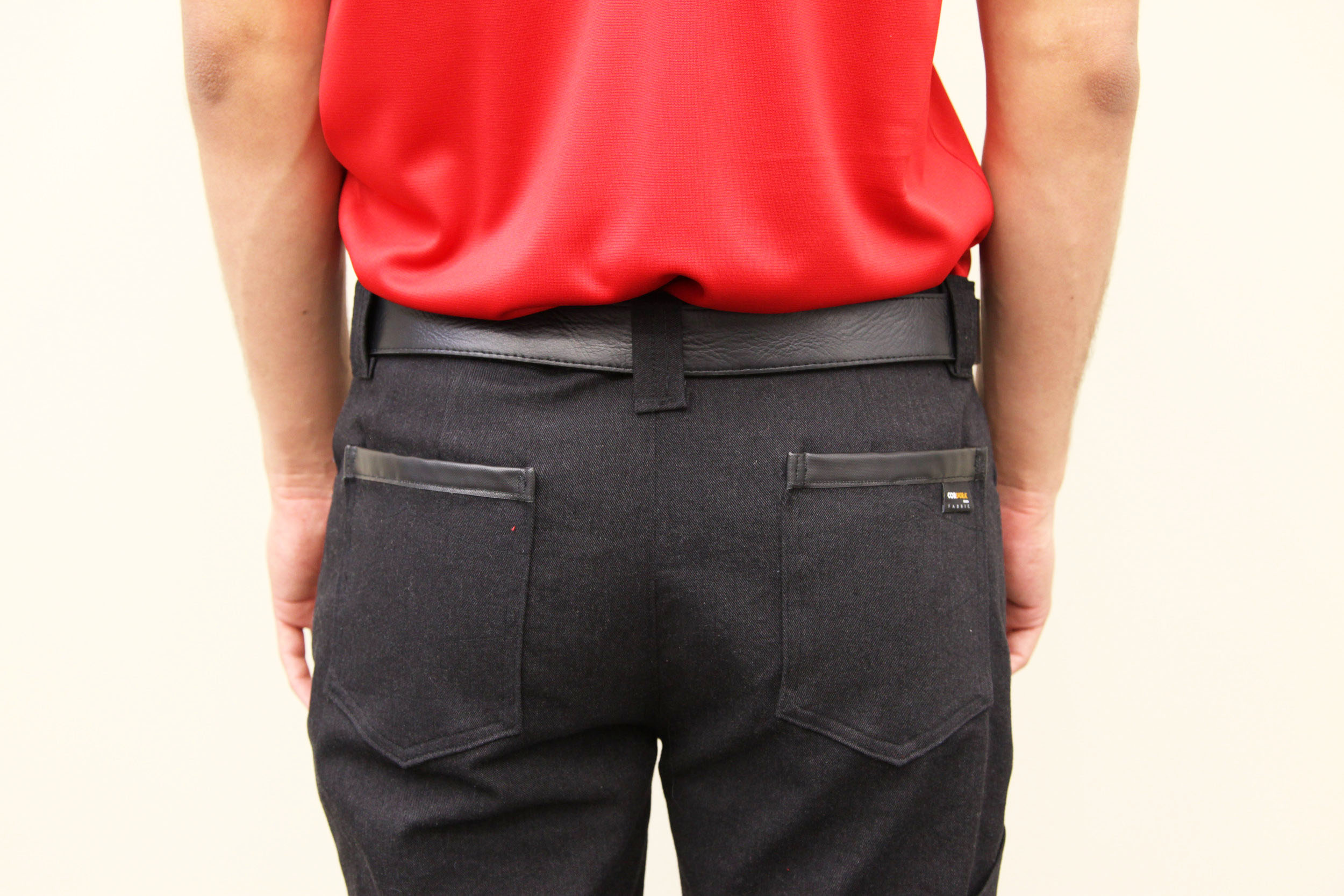 Ballistic Trim at Back Pocket for Durability