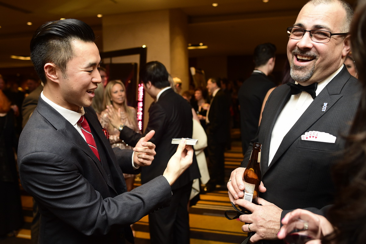 Roving Magic during Cocktails - Whether you're looking to impress your shareholders, or just to let your employees know you appreciate them- our walk-around magicians create the perfect emotional experience for your guests.