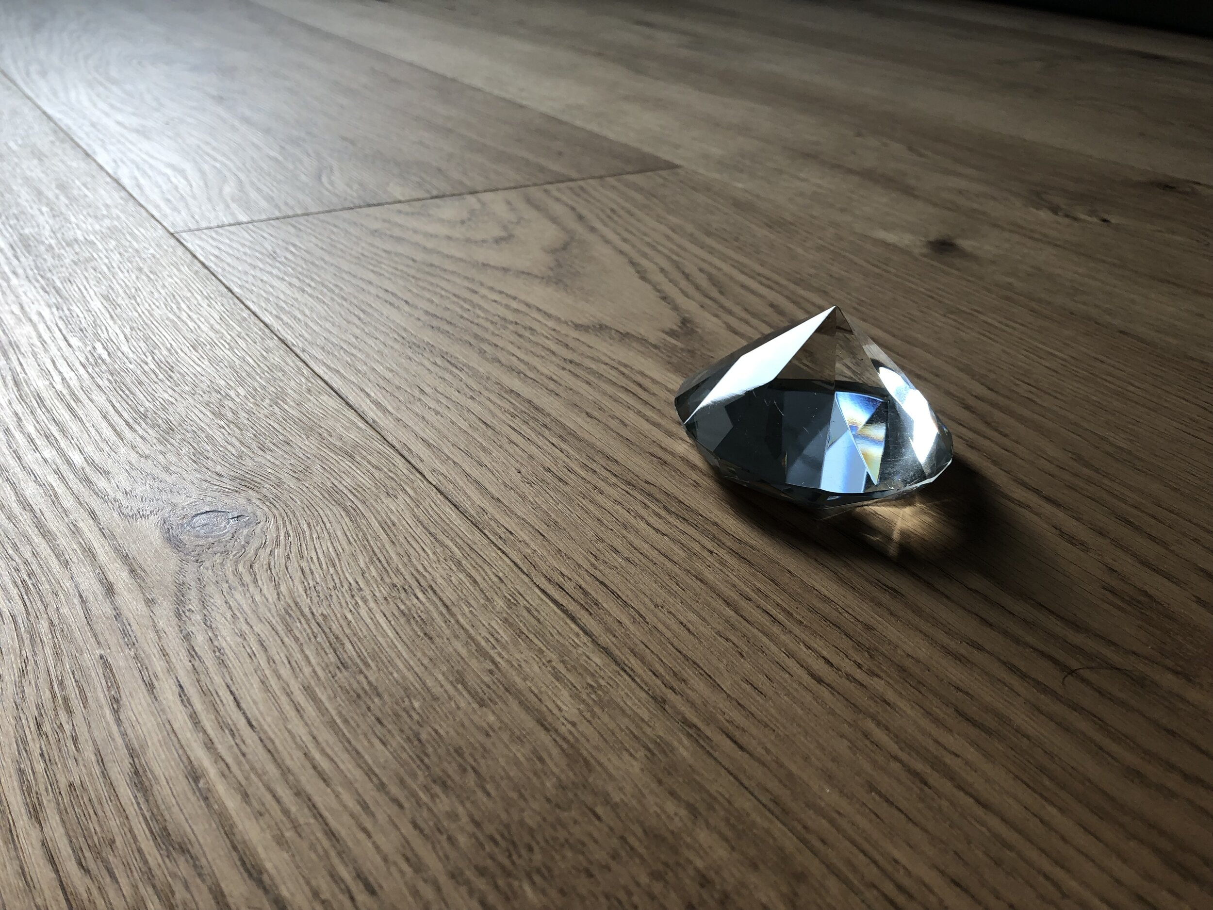 Like a lump of coal is transformed into a diamond, the wood layer is hardened by high pressure and temperature. - - The result is a hardened wood surface that is 3 x stronger than traditional wood flooring.