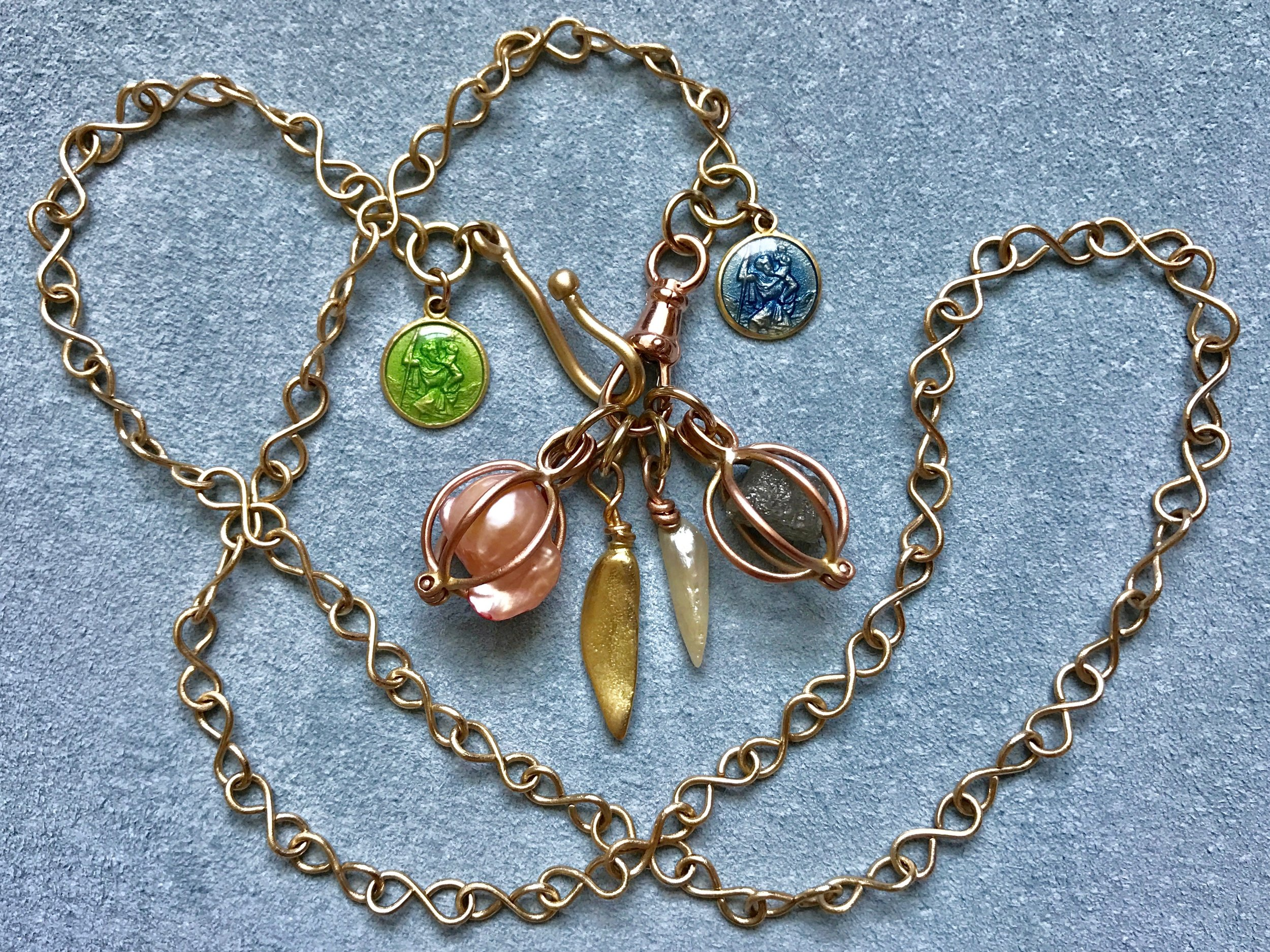 INFINITY CHAIN NECKLACE WITH PEARL BASKET, MISSISSIPPI CAST PENDANT, PEARL, DIAMOND BASKET AND ENAMEL ST. CHRISTOPHER'S