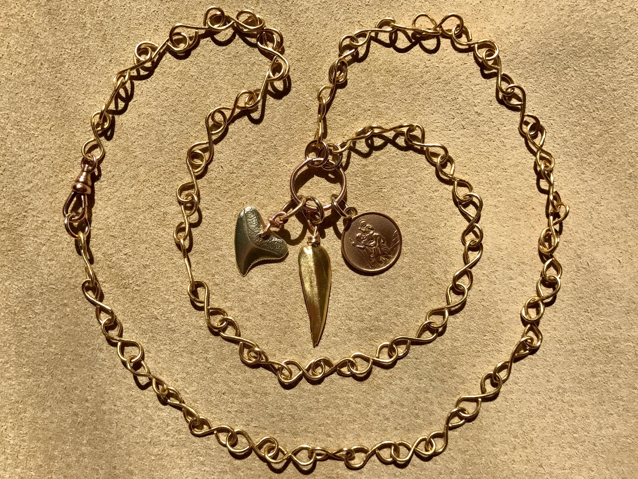 INFINITY CHAIN NECKLACE WITH SHARKS TOOTH, MISSISSIPPI CAST PENDANT AND ST. CHRISTOPHER MEDALLION