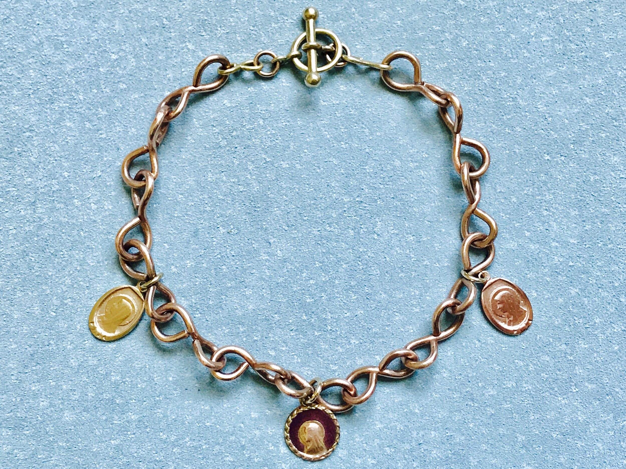 TWISTED INFINITY CHAIN BRACELET WITH MADONNA MEDALLIONS