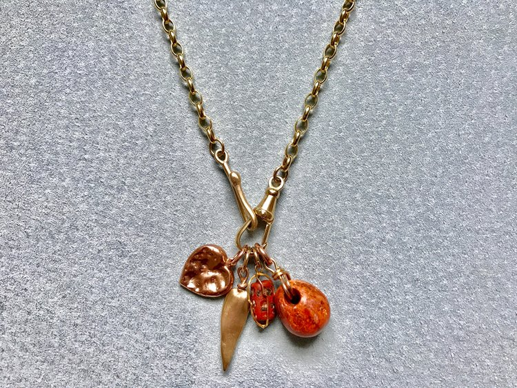 YELLOW BELCHER CHAIN WITH CHEWED HEART, MISSISSIPPI CAST, TRADE BEAD BASKET & NEOLITHIC CARNELIAN