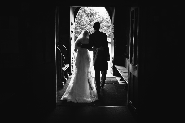 Alice and Wes leaving Church following their Staffordshire Rodbaston Hall Wedding.