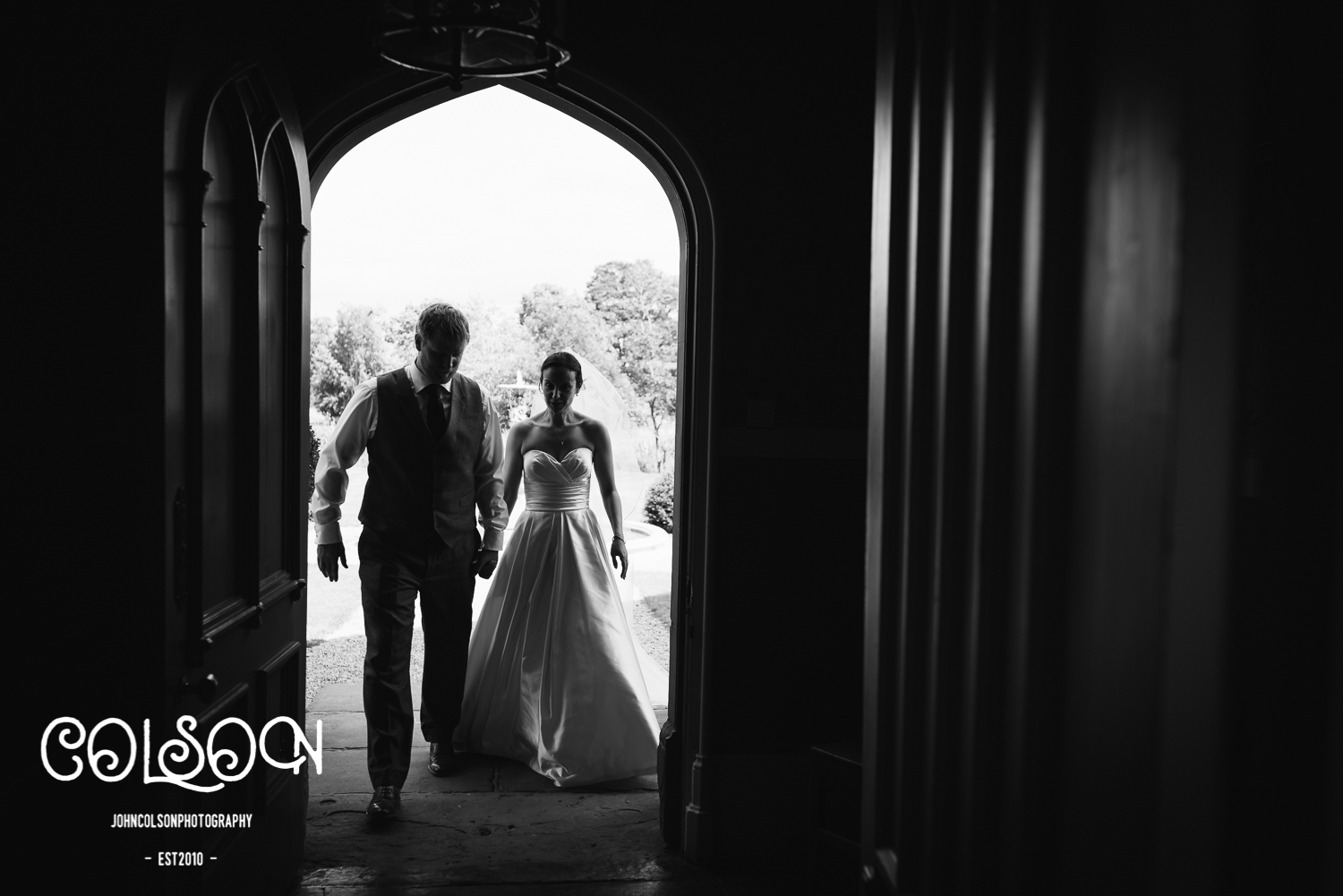 The Bride and Groom making their way to their wedding breakfast at Lemore Manor.