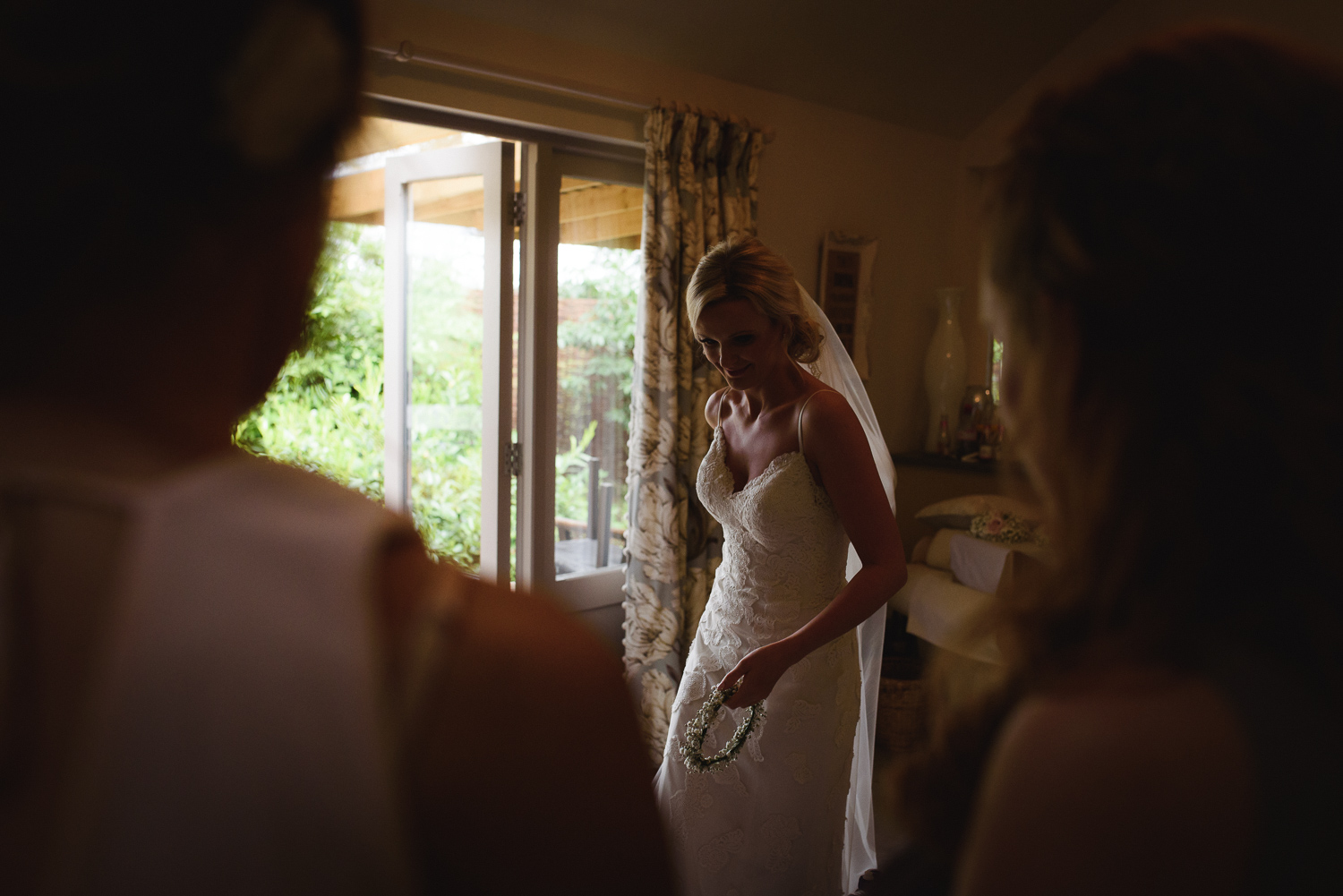 Getting ready for the Wedding Ceremony. Bridesmaids look on at Lemore Manor.