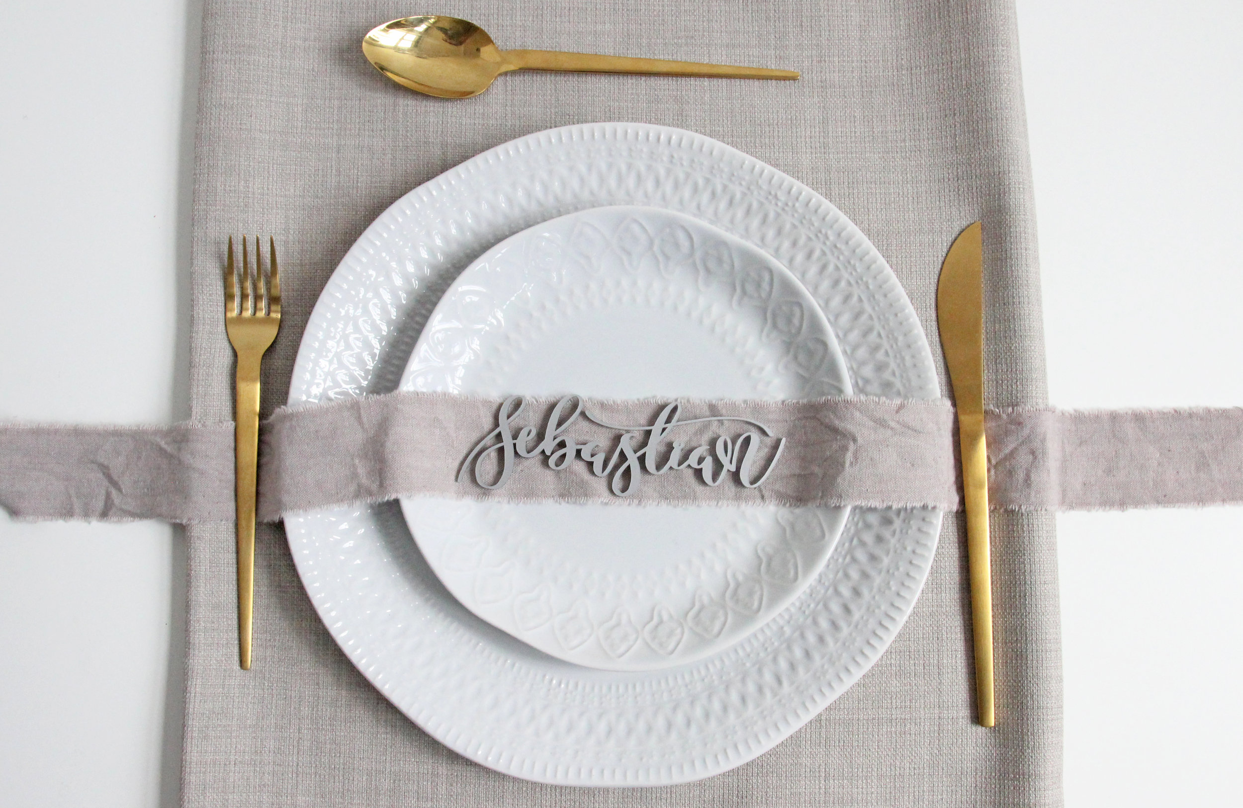 Laser cut cake toppers and wedding signage and place settings