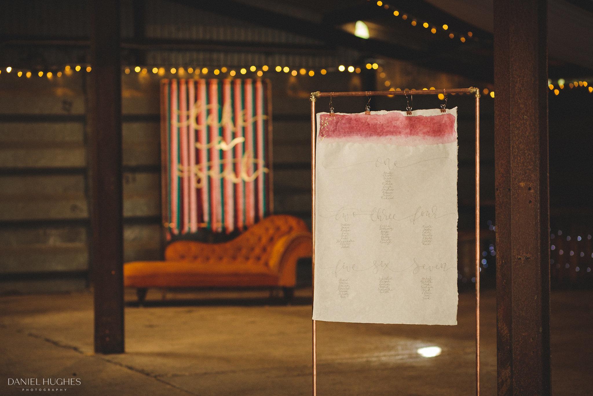 Wedding table plan in modern calligraphy