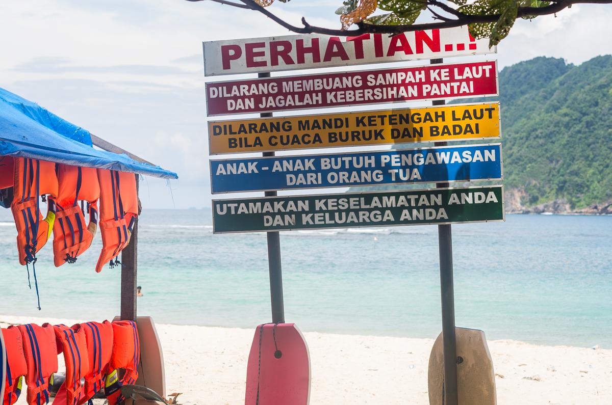 Warning signs at Lampuuk Beach.