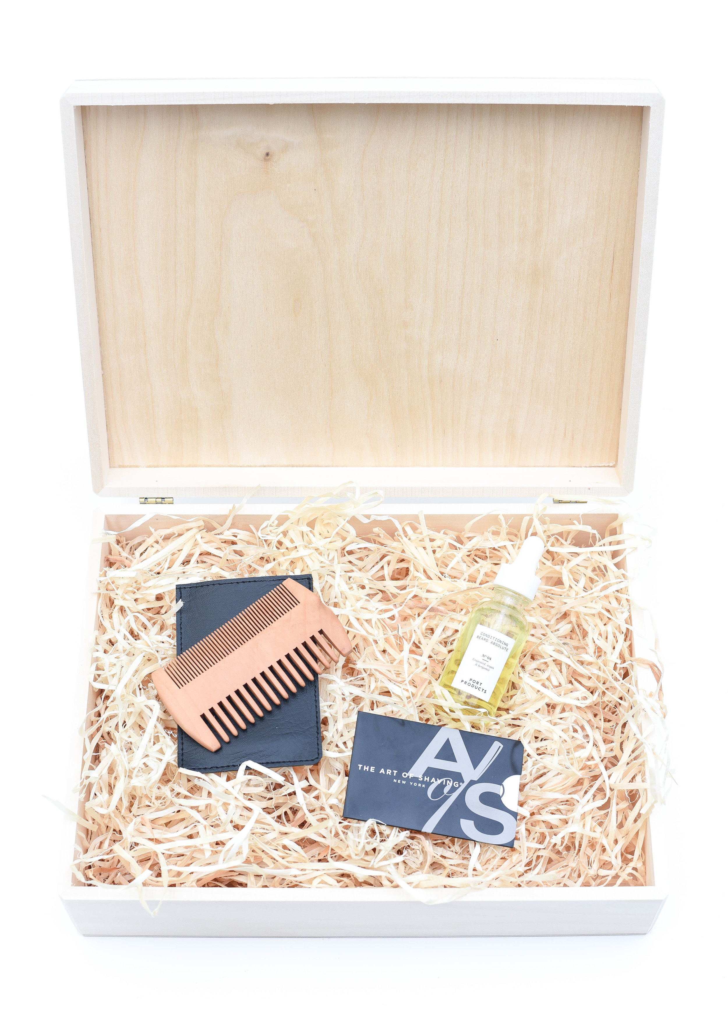 Gift Set for Beards - With a somewhat newly bearded man in my house, I have an inkling you too may have a man or two with facial hair on your Holiday List.  So, to keep things simple, here's a couple of our tried and true picks for Beard Care.  For purchase info, click links below:L:R    Beard Comb   Beard Conditioning Oil   Art of Shaving Gift Card, or better yet pick any of their products for healthy hair growth or  daily skin care  Our go to gift wrap this holiday, shown here:Unfinished Walnut Box (2 pack)   Aspen Wood Excelsior (BULK)Only needing to wrap one present?Individual Unfinished Walnut Box   Aspen Wood Excelsior (4 oz bag)