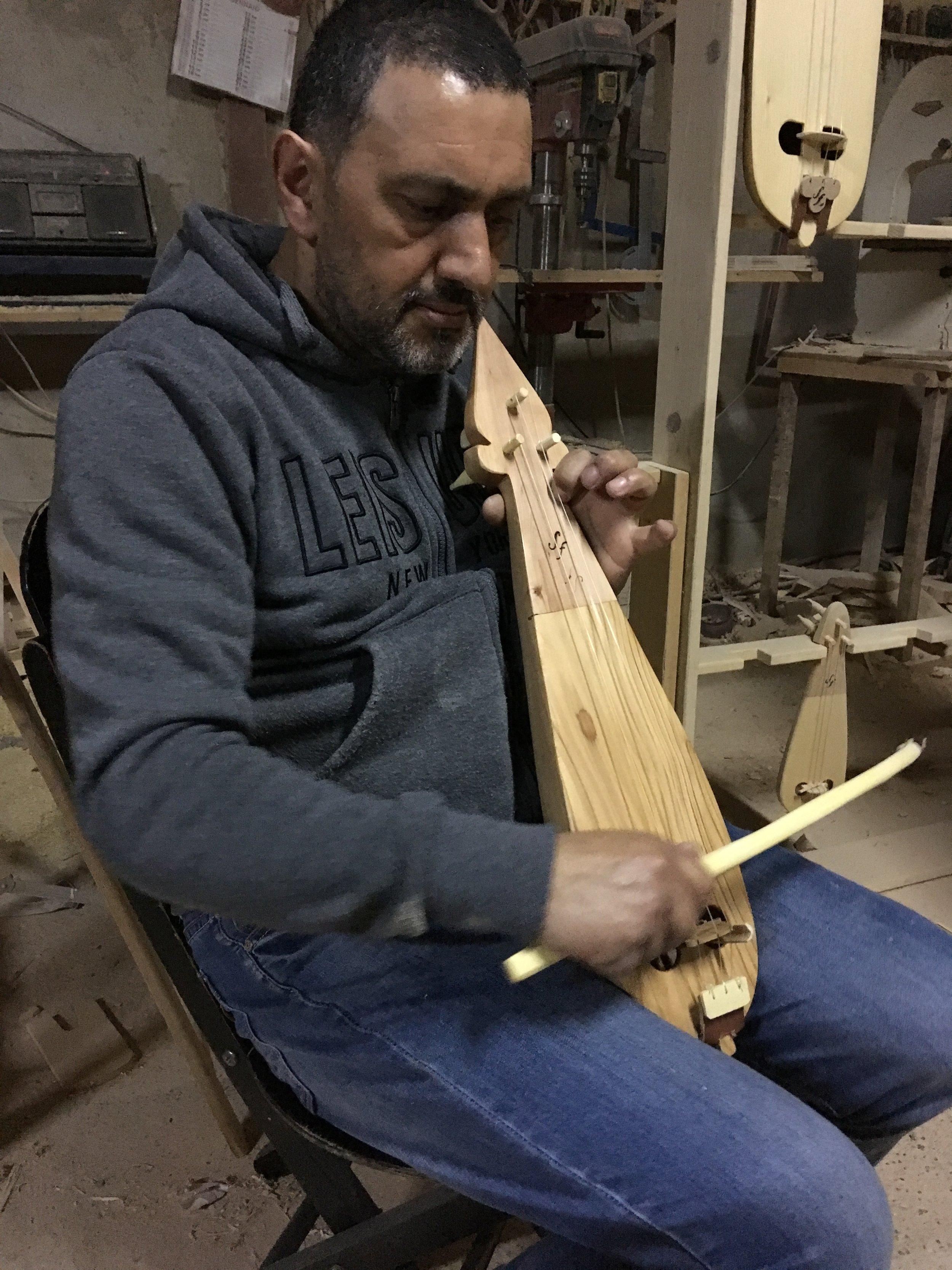 Francesco Siviglia playing one of his instrument, Bova Marina, Calabria, Italy