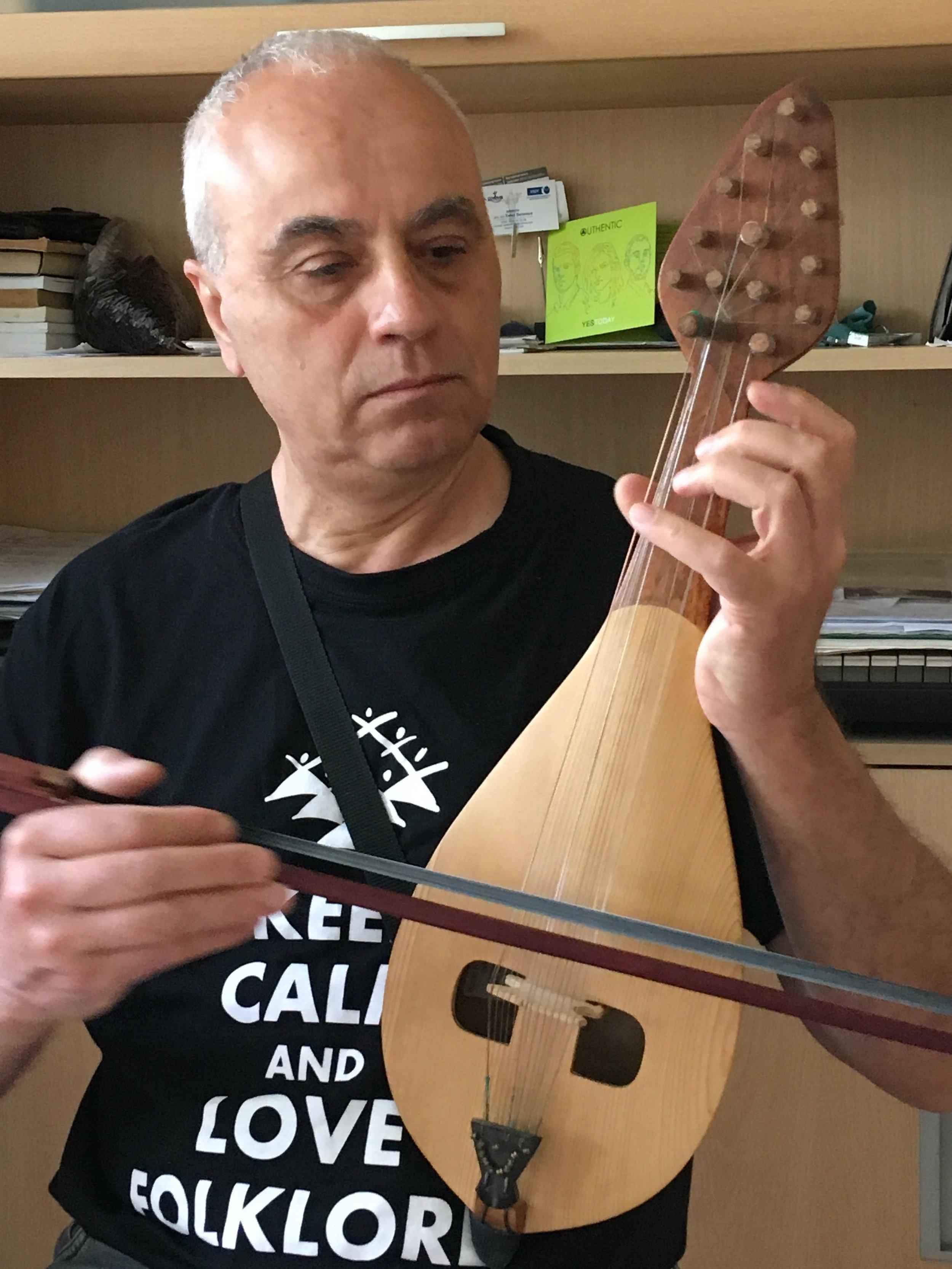 Angel Dobrev playing gadulka, Sofia, Bulgaria