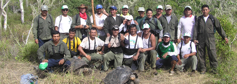 Galapagos National Park Guards proudly pose on Pinta Island, after having carried 39 Giant Tortoises into the highlands. Photo by Joe Flanagan