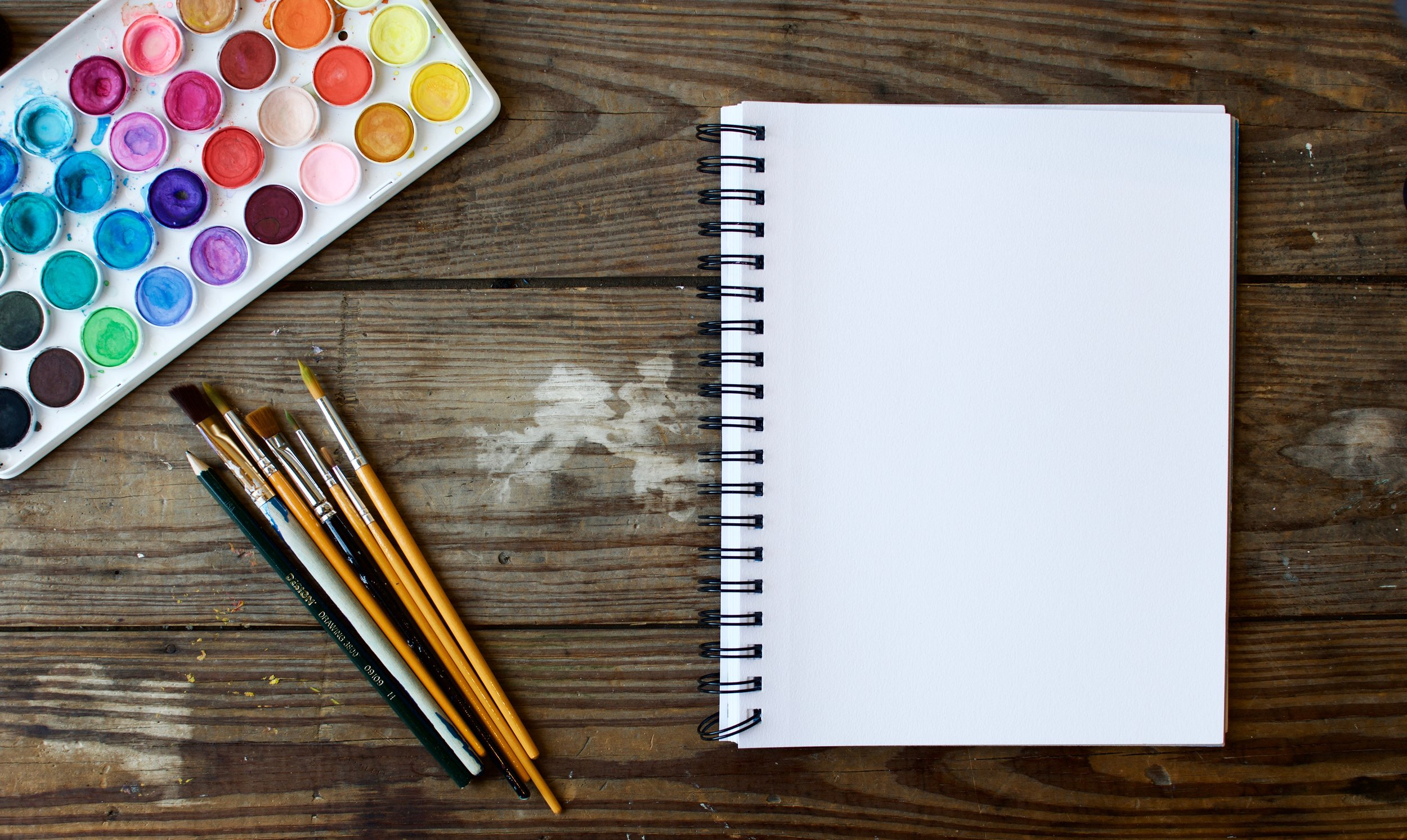 A Blank Page With Paint & Paintbrushes