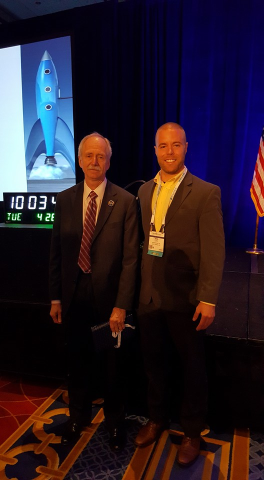 William H. Gerstenmaier, NASA's Associate Administrator for Human Exploration and Operations, and Masterclock CEO John Clark