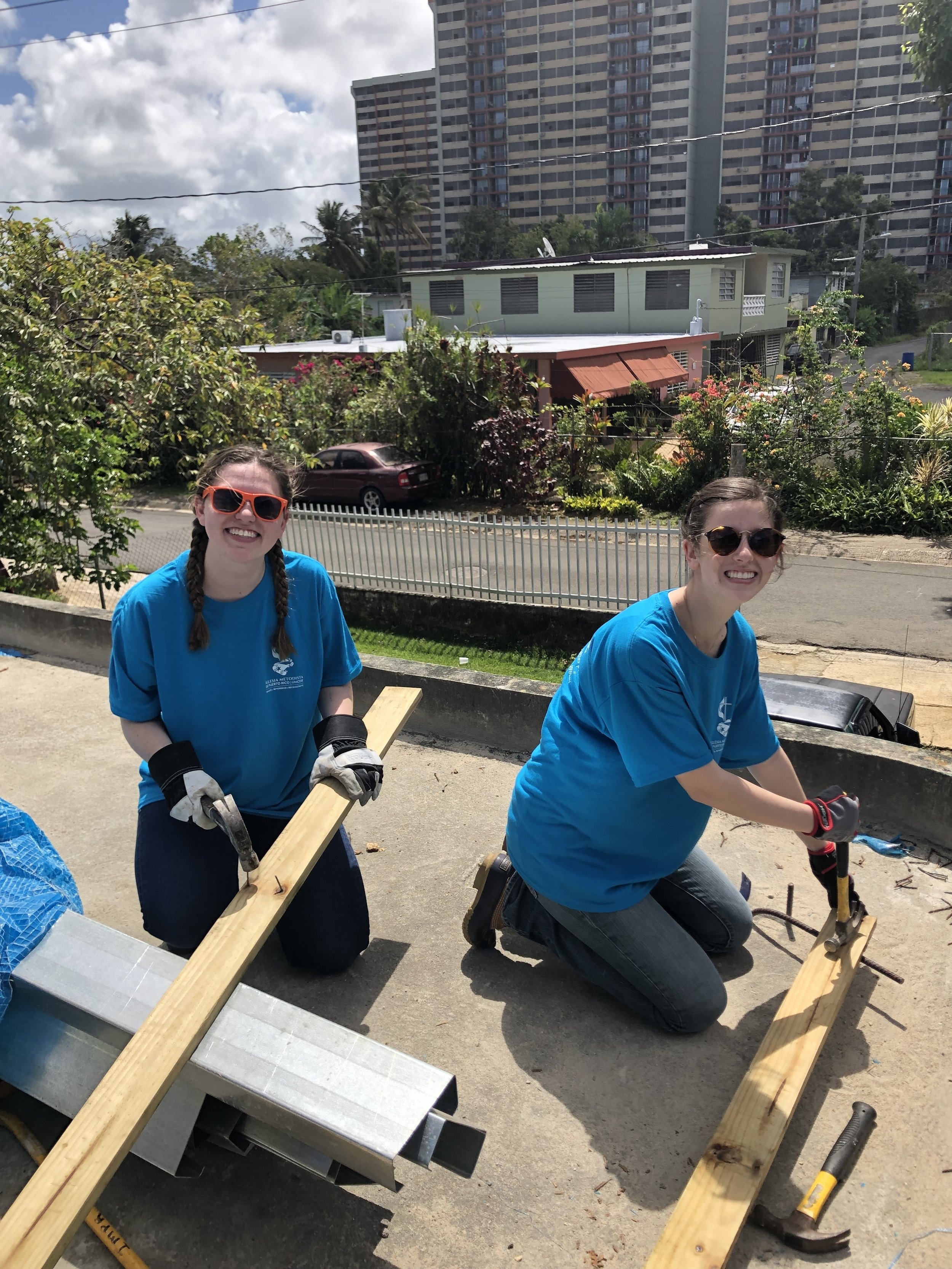 Lindsey Baird and Tatum Connell from Team 1 removing the nails from the boards that were part of the temporary tarp roof (as mentioned above)