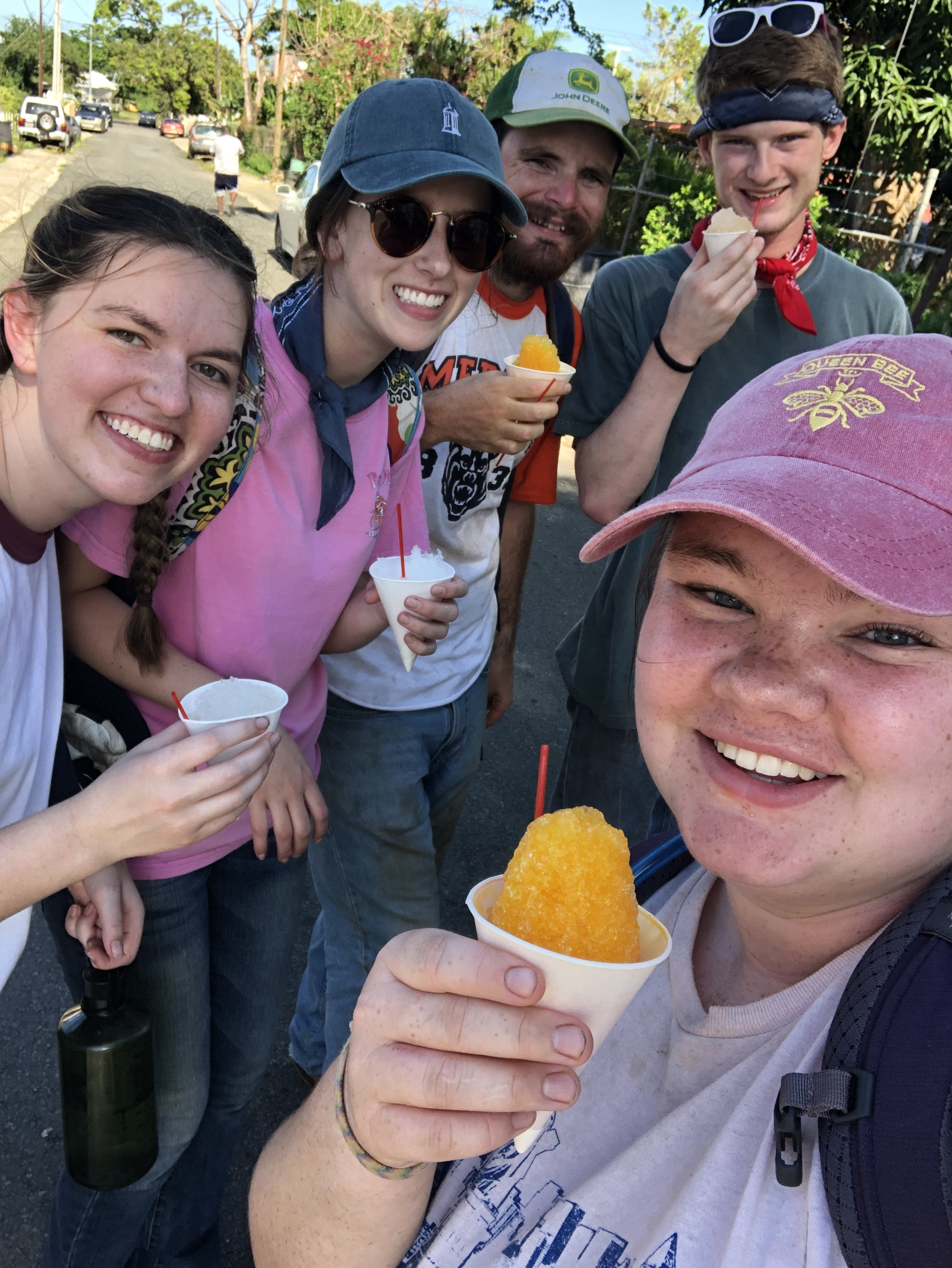 Lindsey Baird, Tatum Connell, JT Mercer, Richard White, and Becca Lamb smile as they got surprise snow cones from a local vendor after a long and hot day of work