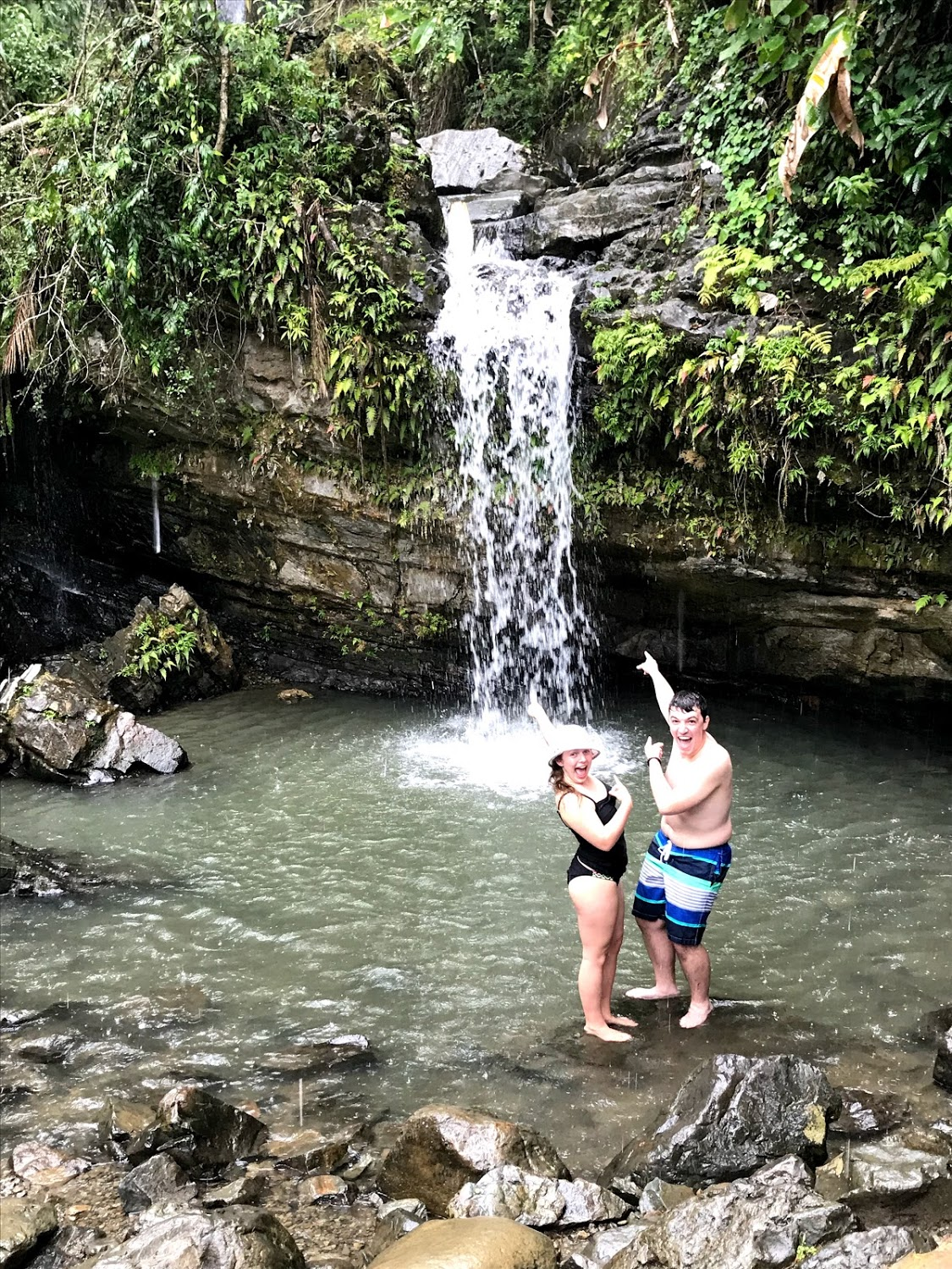 Korie Burgess and Josh Ellis are very excited to jump into a natural spring in the Yucatán Rainforest