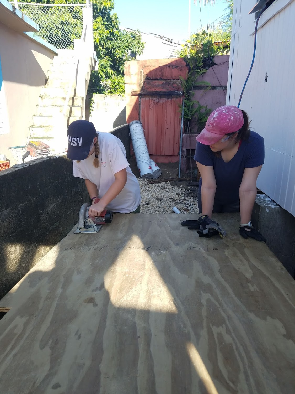 Megan Kucera and Sarah Jane Thompson cut some wood