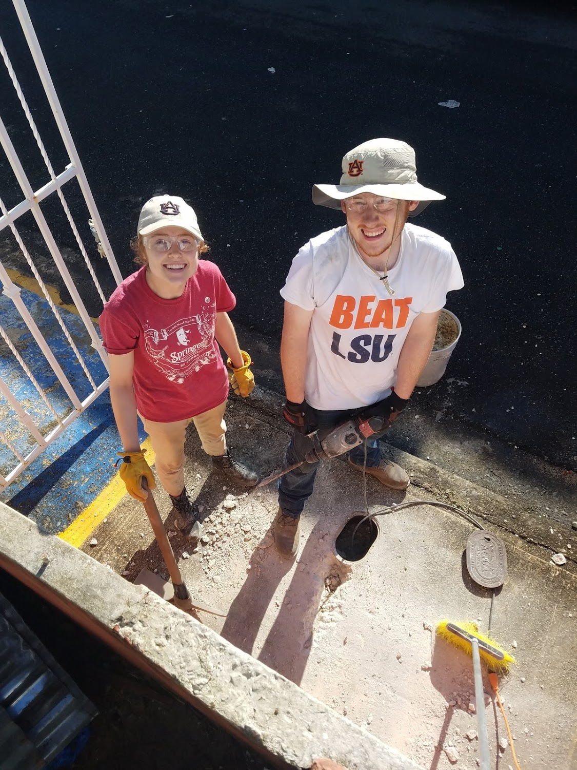 Bekah Wommack and Ben Gourley smile for a pic as they try to locate a pipe leak