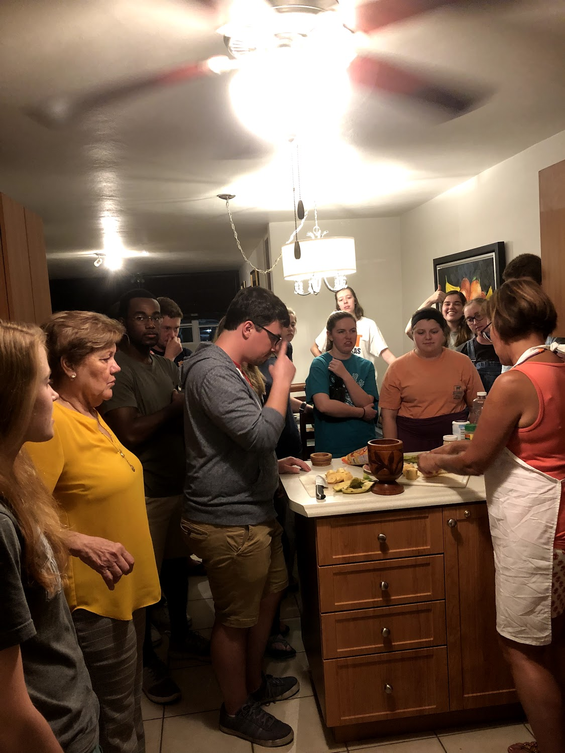 The entire team learning how to make tostones and mofongo from Ivonne, our translator