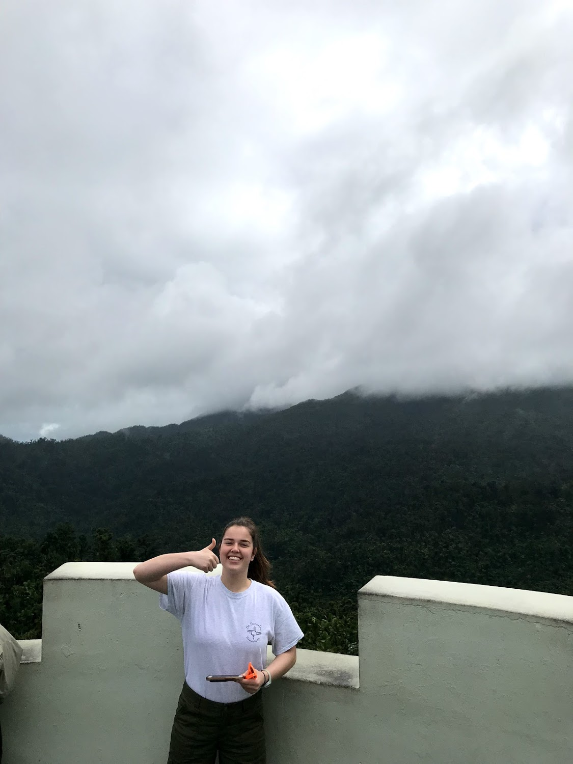 Sarah Jane Thompson smiles at the top of a lookout tower in the Yucatán Rainforest