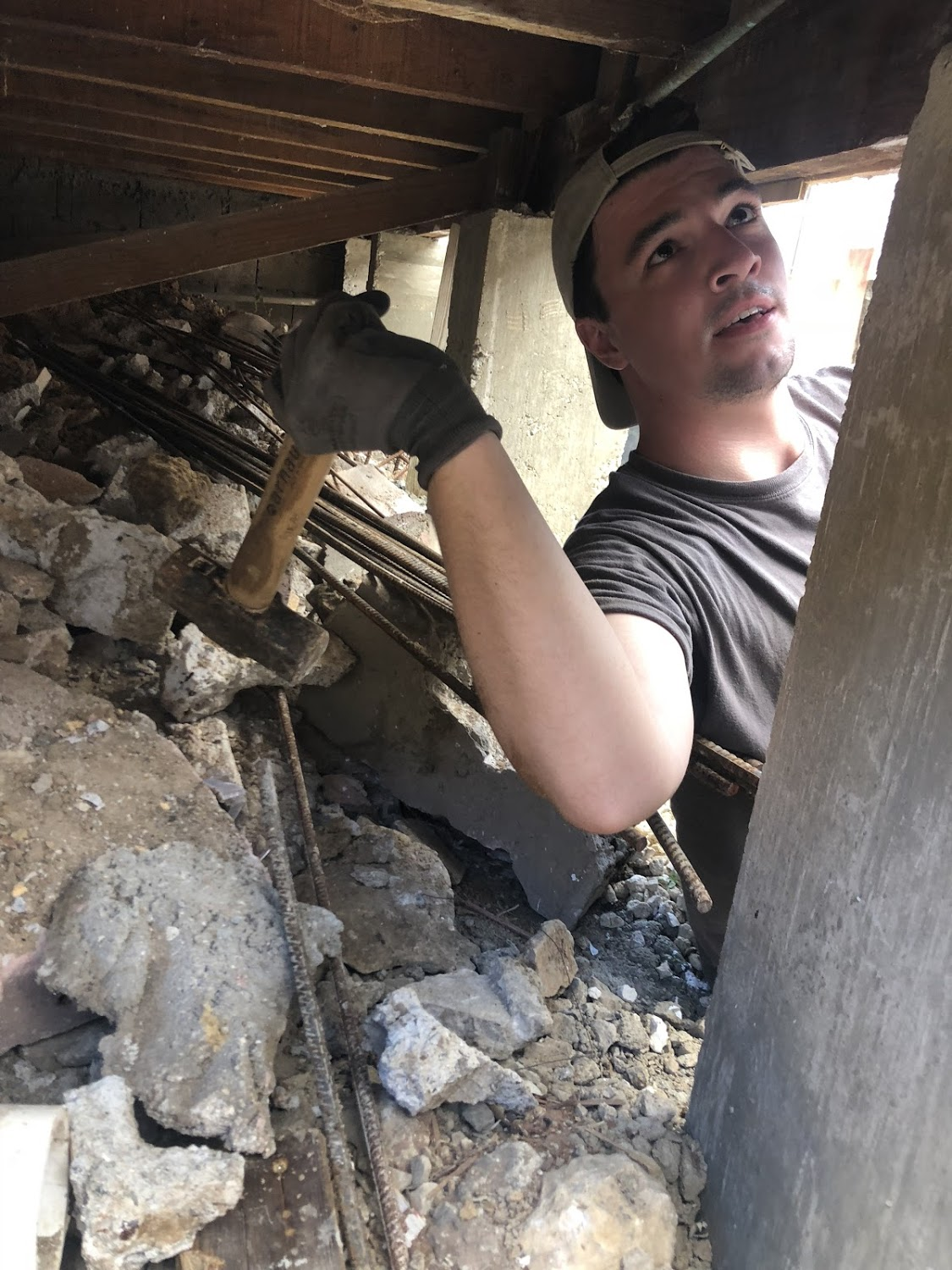 Josh Ellis takes a hammer to the under side of the house he was working on