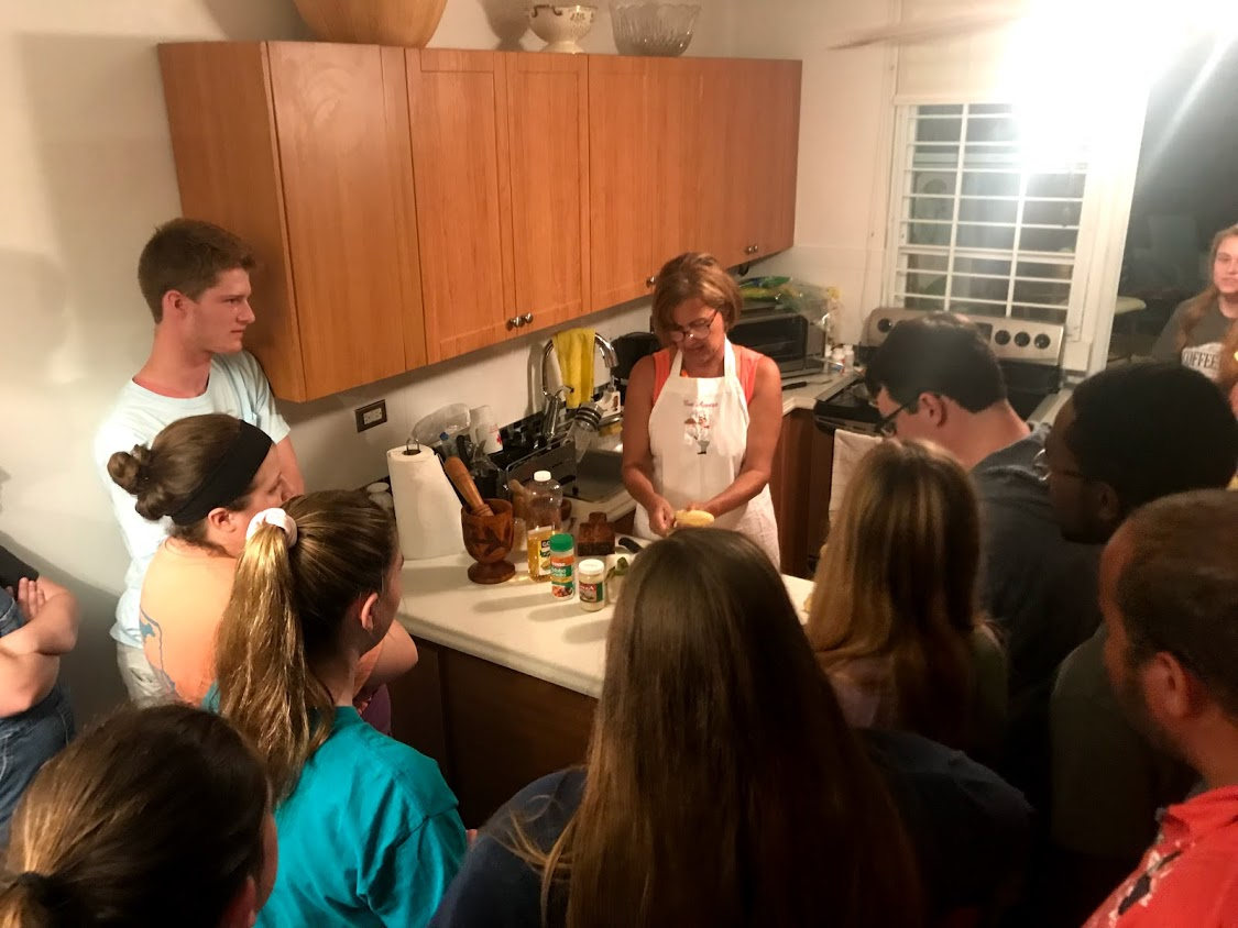 Another photo of the group learning how to make mofonog and tostones