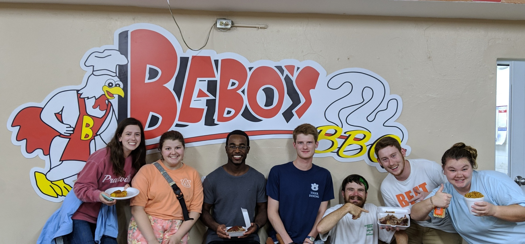 from left to right: Tatum Connell, Taylor Vaughan, AJ Stanley, Richard White, JT Mercer, Ben Gourley, Becca Lamb at Bebos BBQ