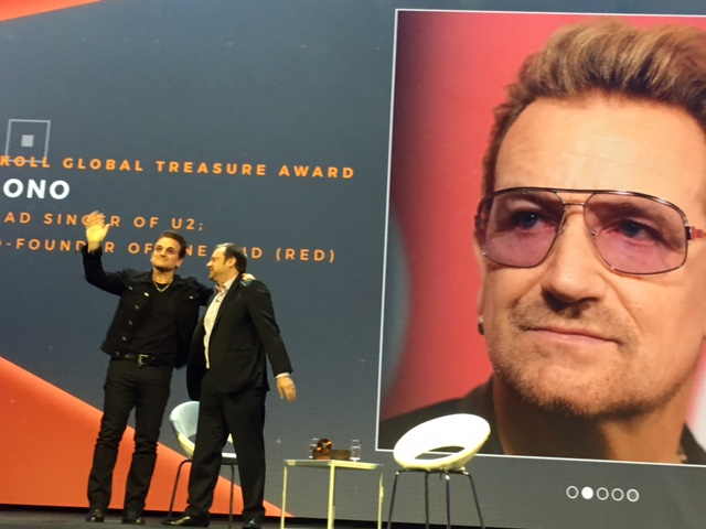 Bono accepting his award from Jeff Skoll.
