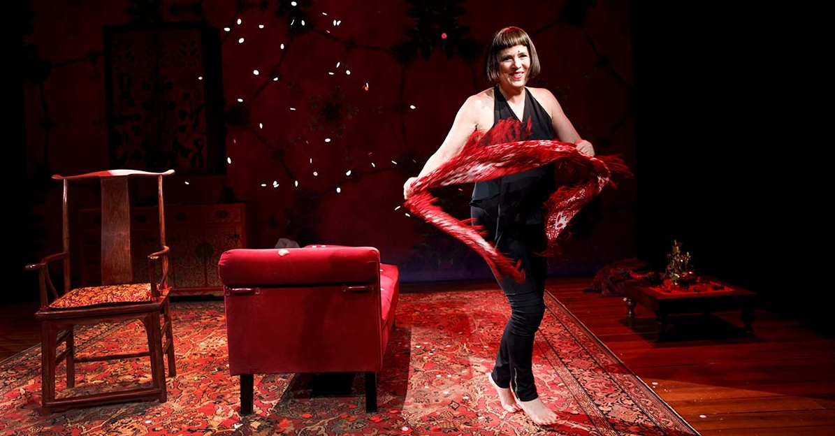 "Eve Ensler performing in her one-woman play, ""In the Body of the World."" (Photo by Joan Marcus)"