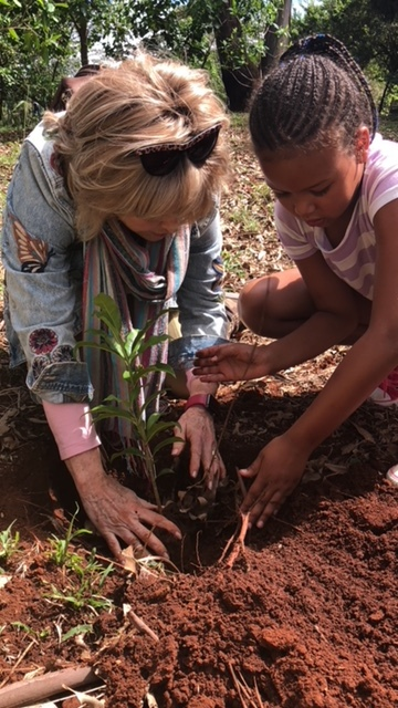 Planting a tree with Ruth in Kenya.