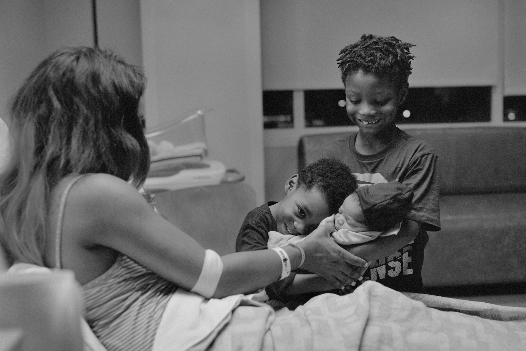 A mother introducing her new baby to his brothers. Credit: LaToya Ruby Frazier for  The New York Times.