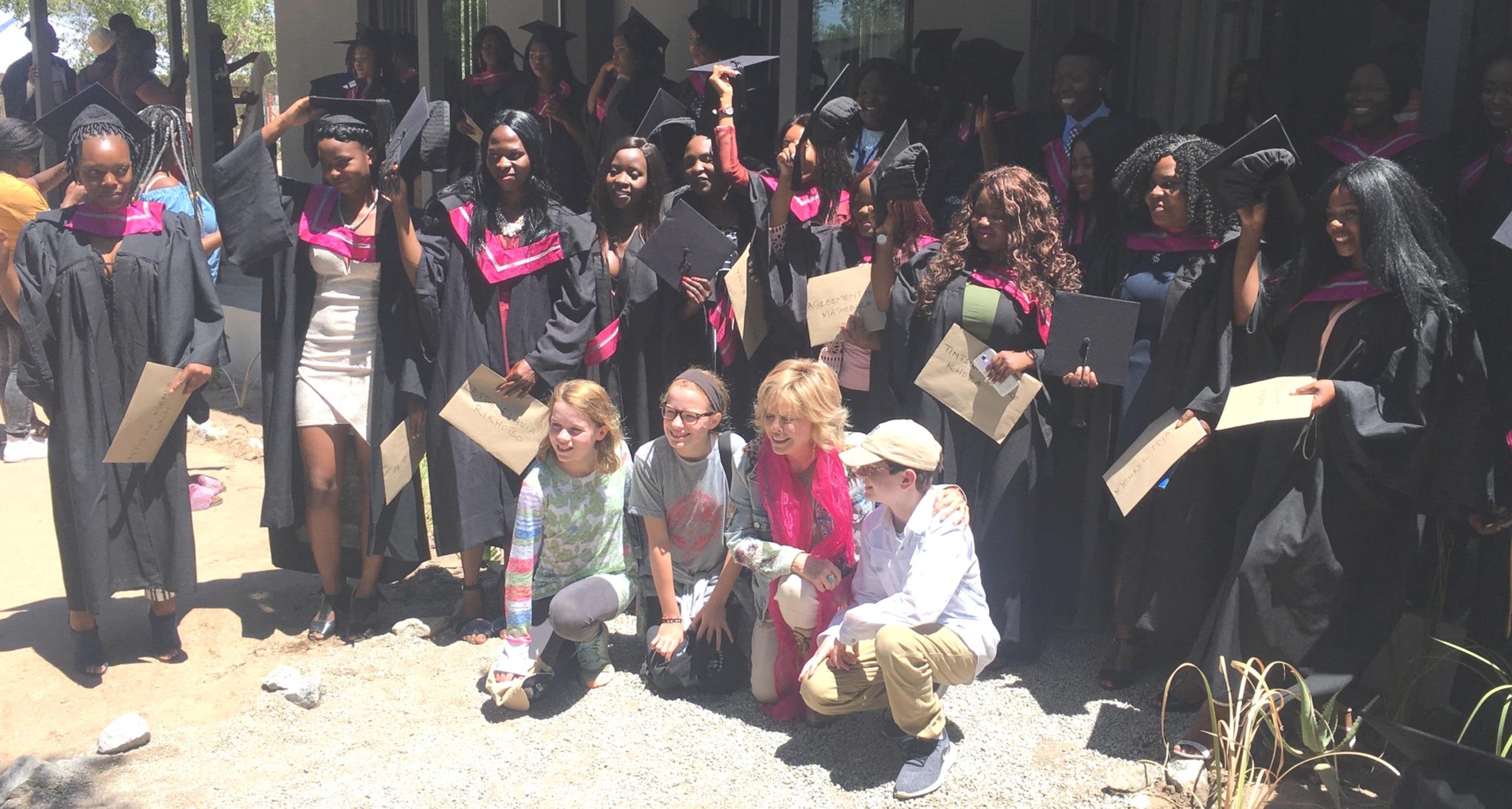 Graduates, Pat and her grandchildren celebrating after the graduation ceremony.