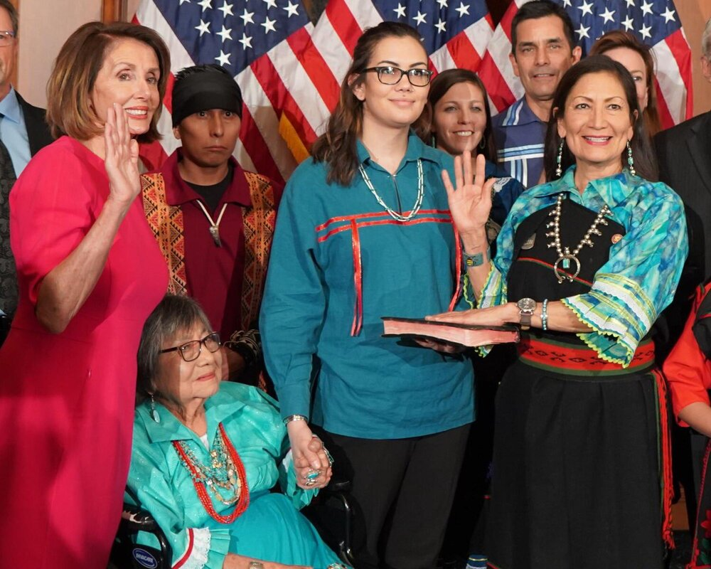 Deb Haaland sworn in to Congress by Speaker Pelosi wearing her traditional Pueblo clothing. She is here with her daughter (left), her mother (seated), and her extended family, on Jan. 3, 2019.