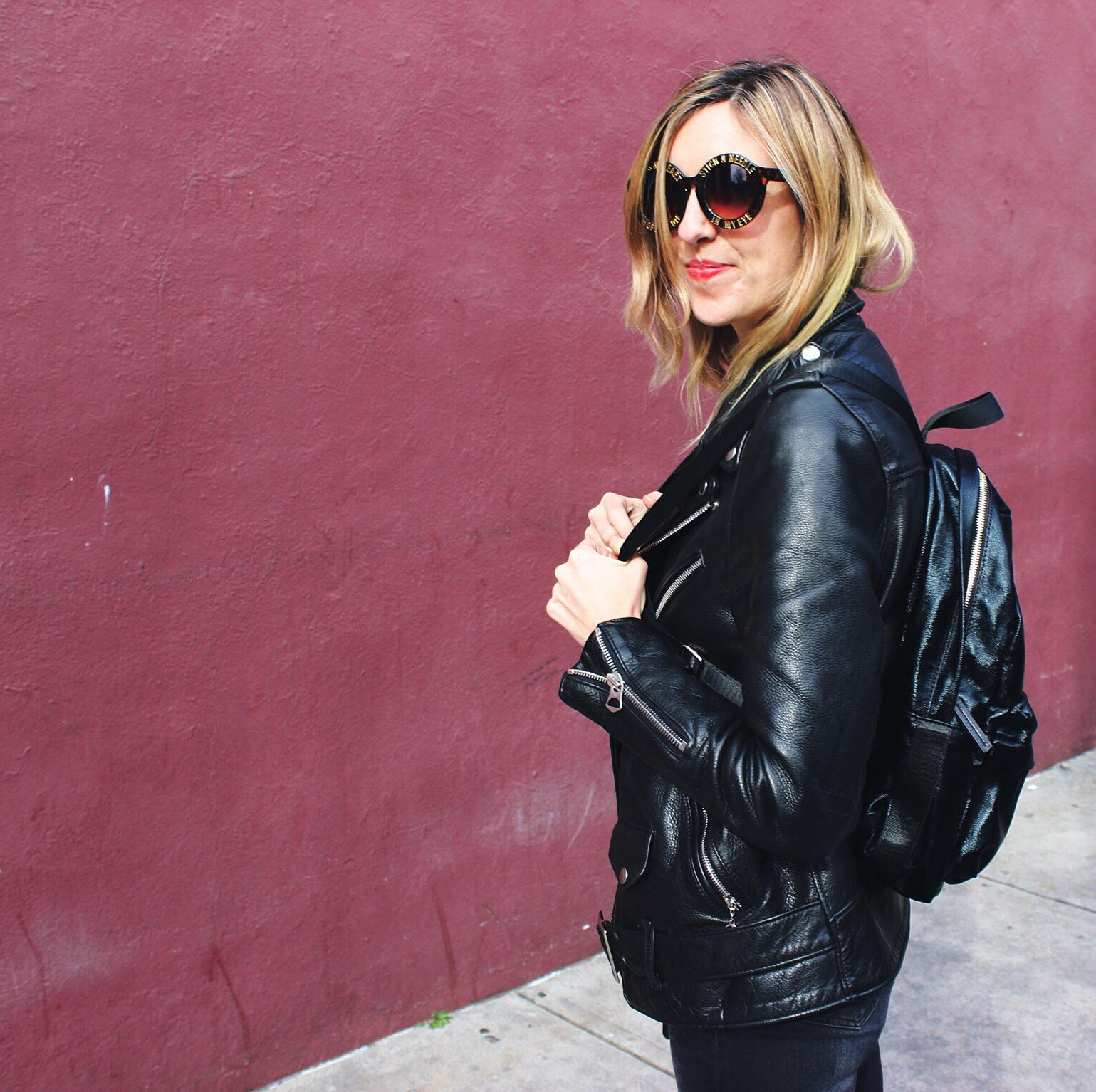 """My caption opened with the emoji rock n roll hand and then the copy """"Jacket by Wunderleathers, backpack from Galian Handbags. Taken at the Georgia Theater by Ben Alleman"""" (this is a fashion x music x travel post!)"""