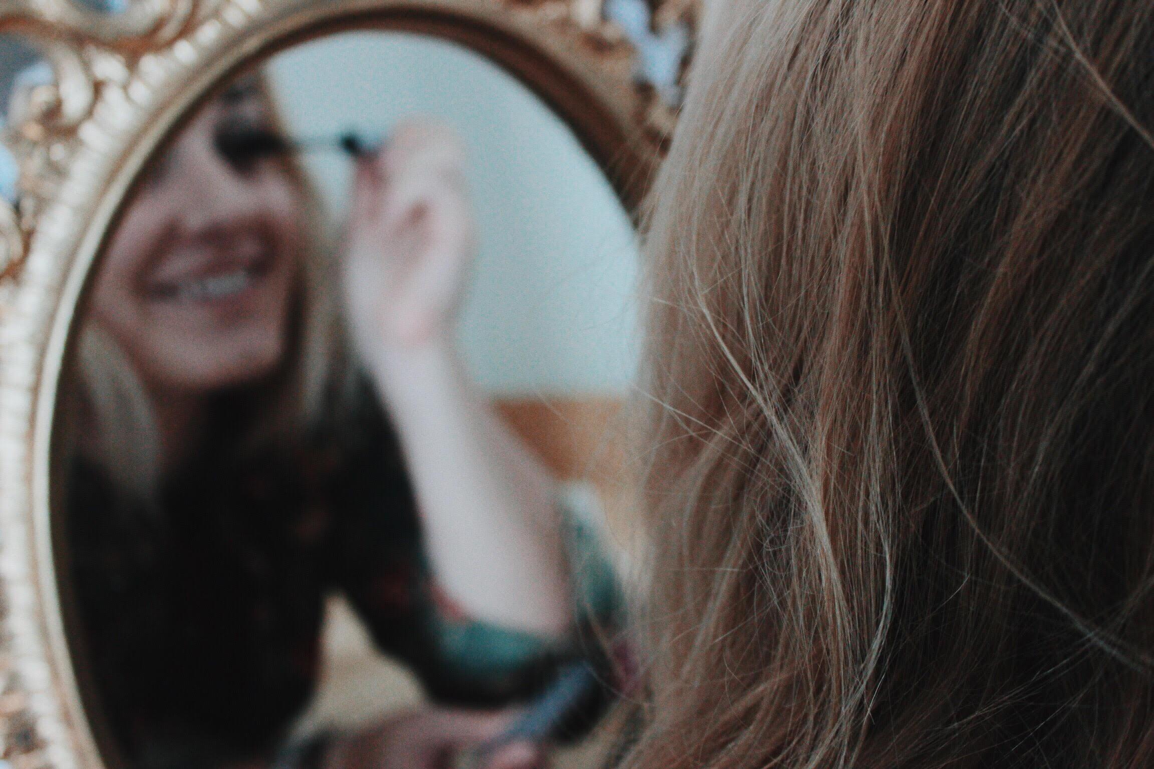Chelle applying mascara like a pro