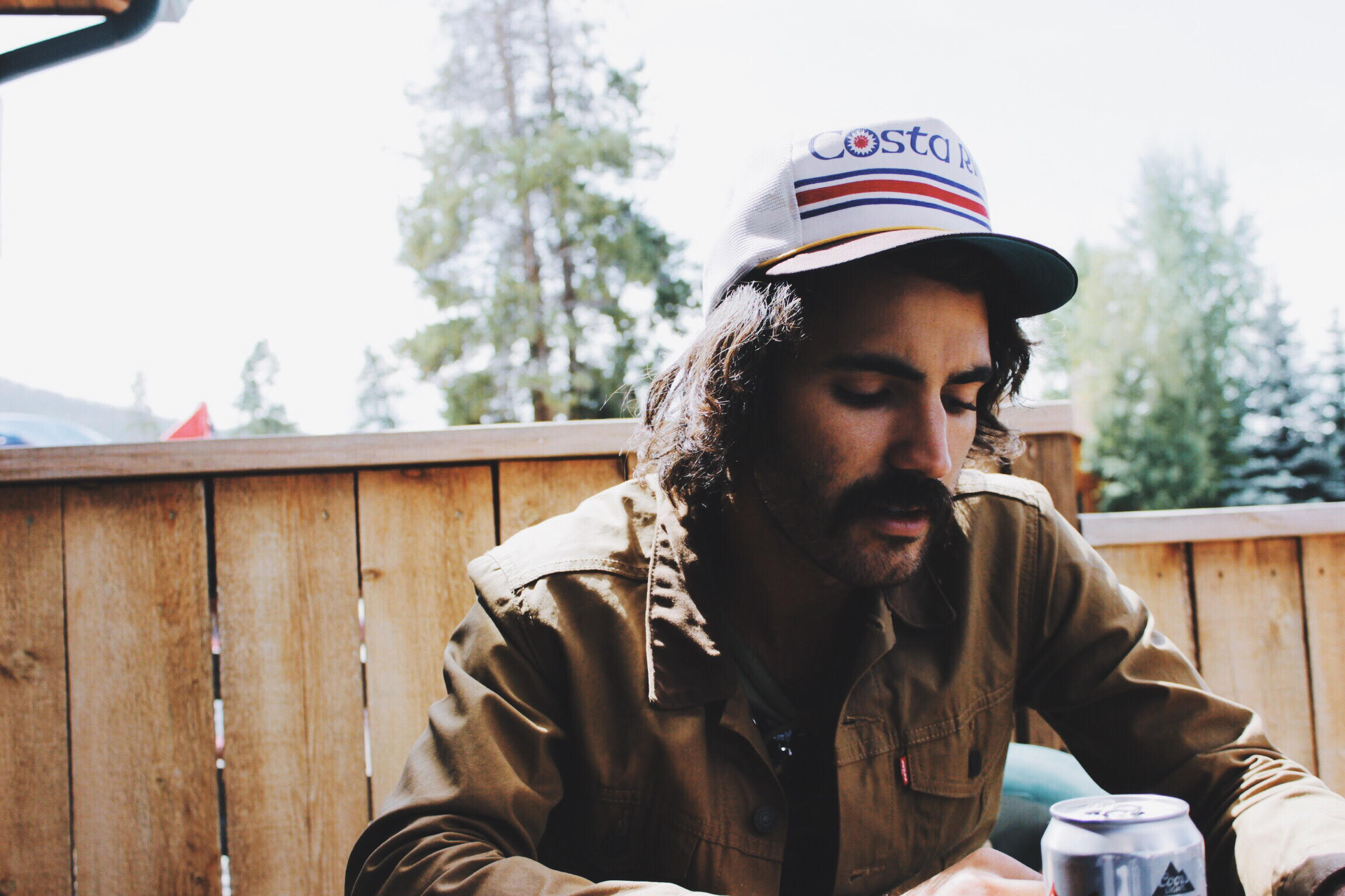 I snapped these photos of Ben as we sipped beers and shared stories after an early morning hike.