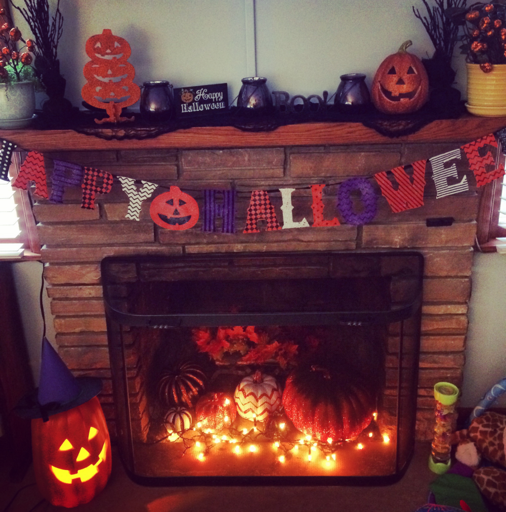 Mantles are great places to put decorations where your children can't destroy them. Notice my sparkly pumpkins behind a metal shield that has fallen on my son so many times he won't go near it.
